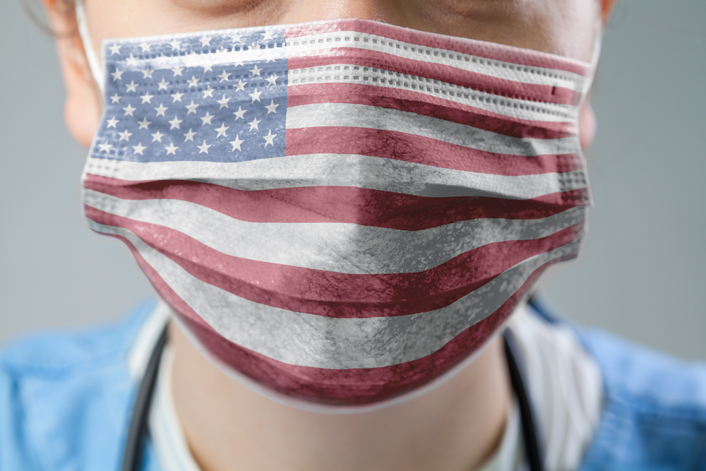 Person wearing surgical mask with the American flag on it.