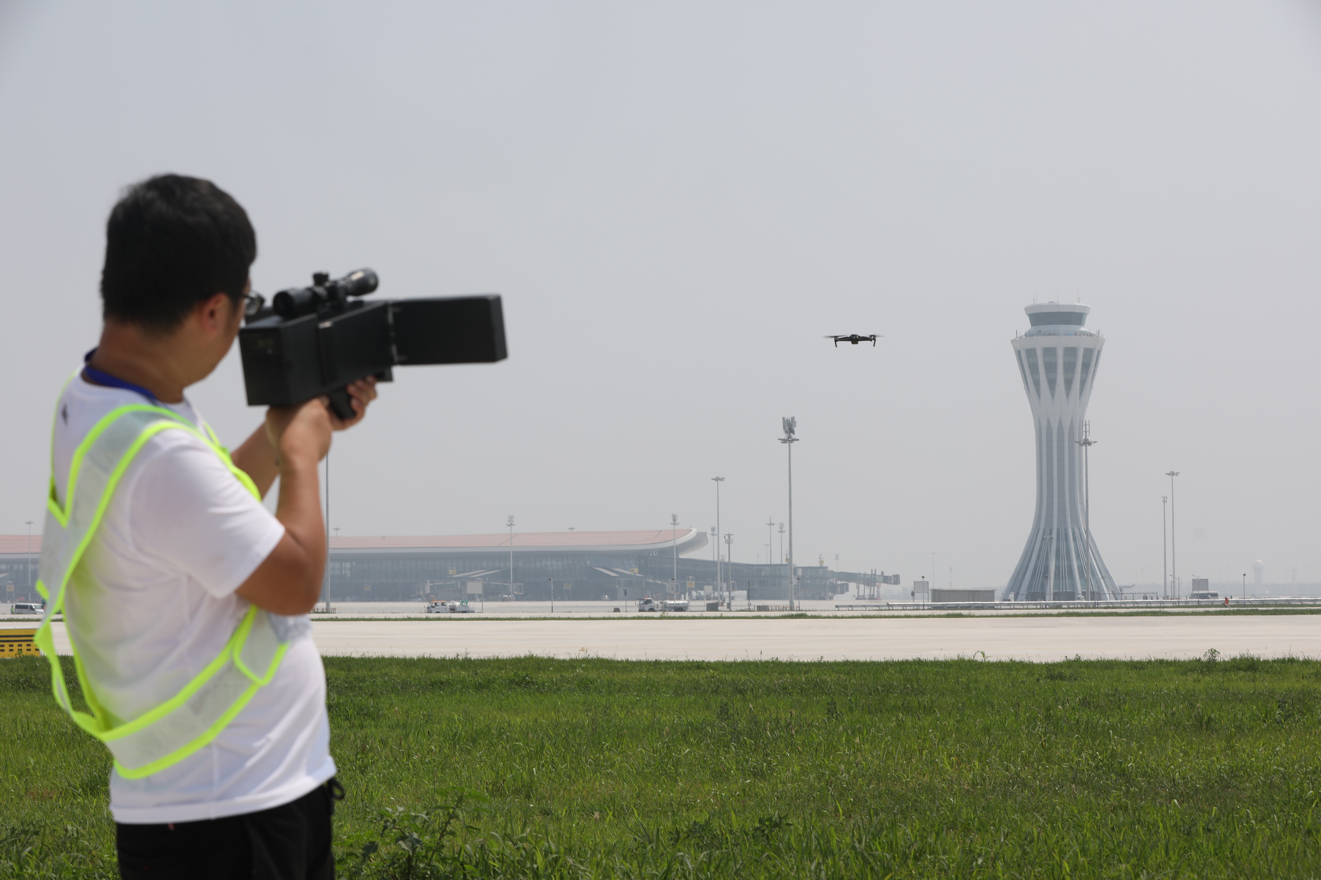 Staff take the test to keep drones away from Beijing Daxing International Airport with various devices, Beijing, China, 12 July 2019.  An Anti-drone test is conducted at Beijing Daxing International Airport before it comes into service in Beijing, China, 12 July 2019.No Use China. No Use France.