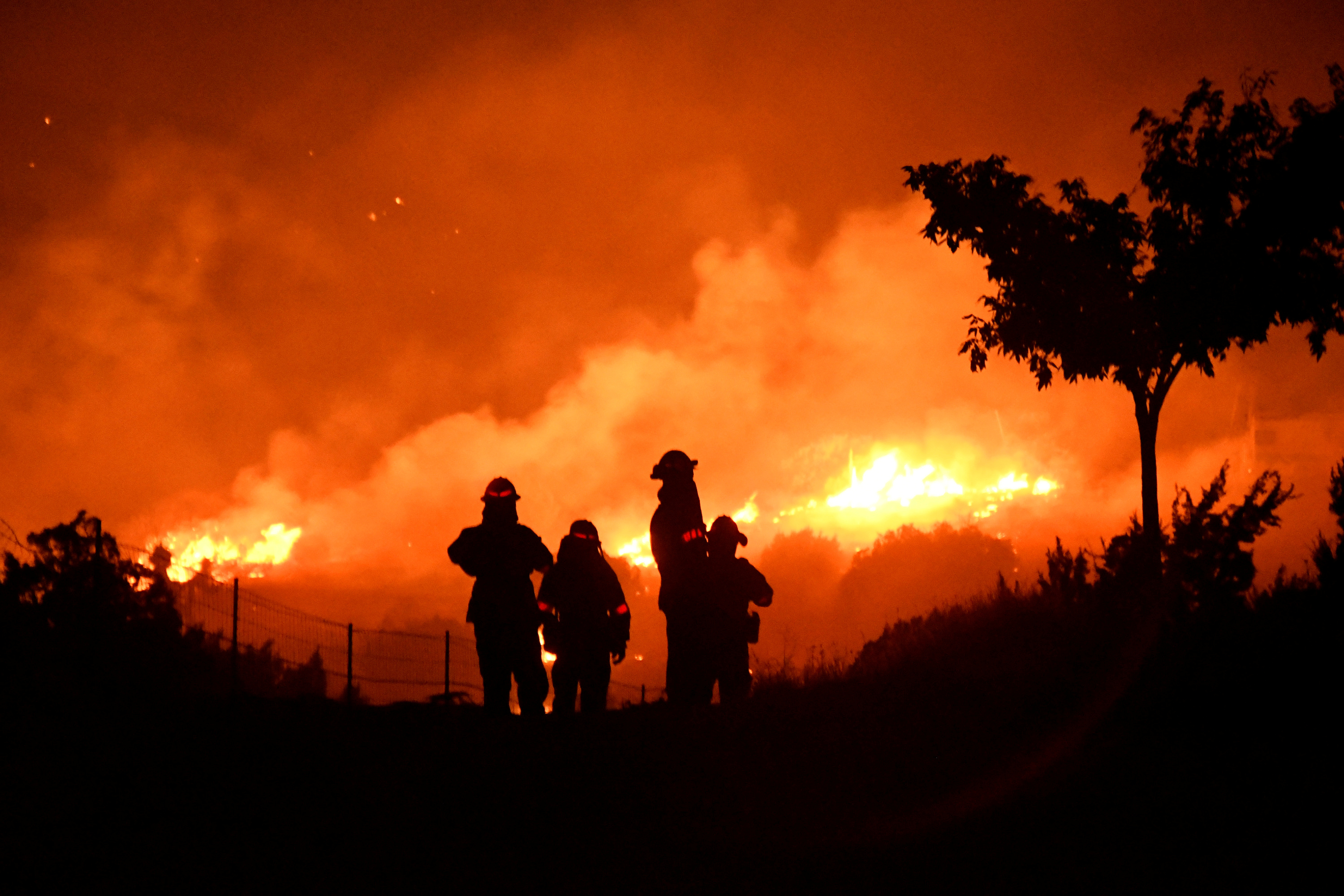 FILE PHOTO: Los Angeles County firefighters keep watch on the Bobcat Fire as it burns through the night in Juniper Hills, California, U.S. September 19, 2020.  REUTERS/Gene Blevins/File Photo