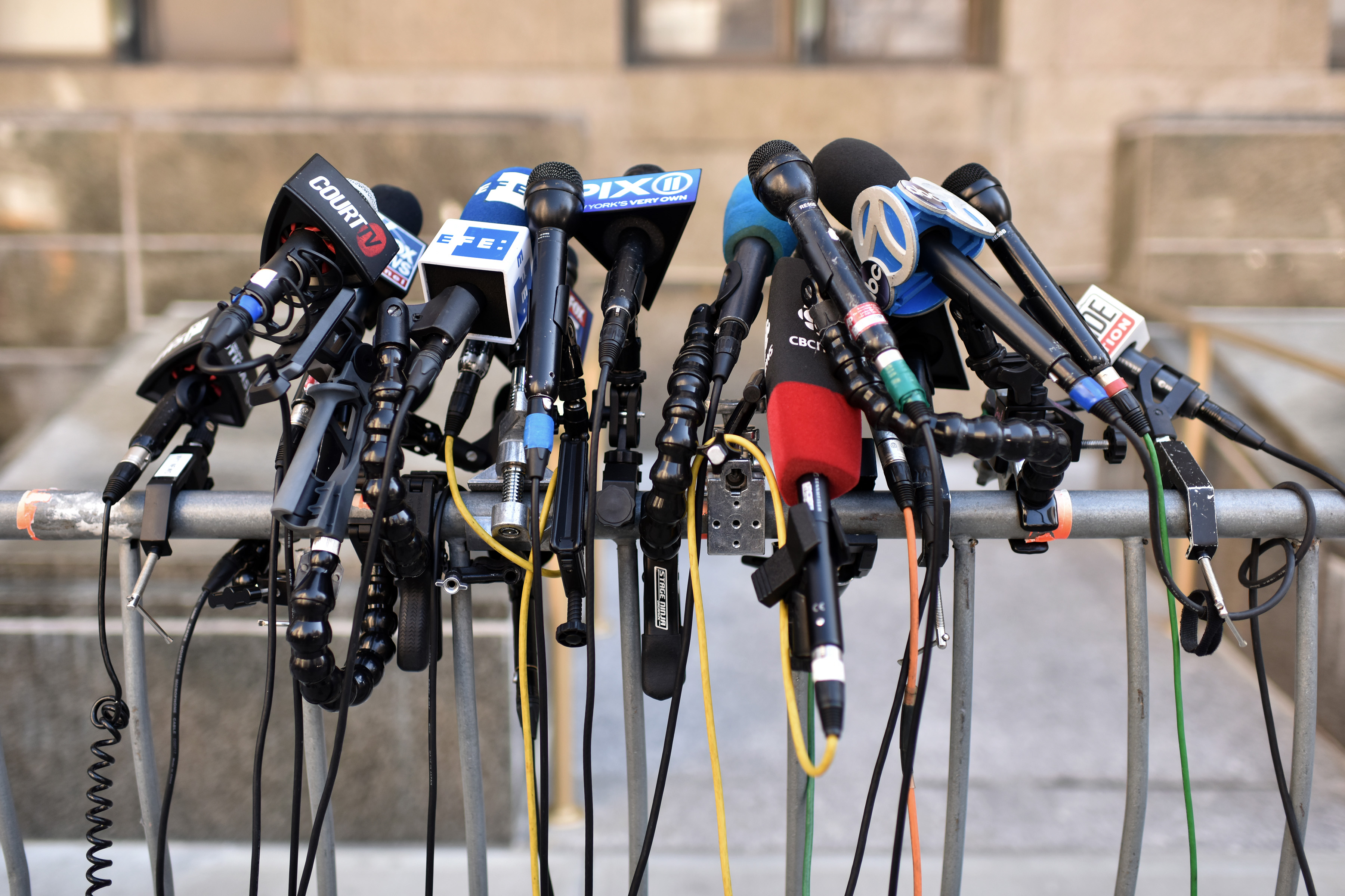 Microphones at the ready as members of the press wait outside the courts as jury deliberates for a second day in the Harvey Weinstein rape trial case at New York City Criminal Court, New York, February 19, 2020. (Anthony Behar/Sipa USA)No Use UK. No Use Germany.