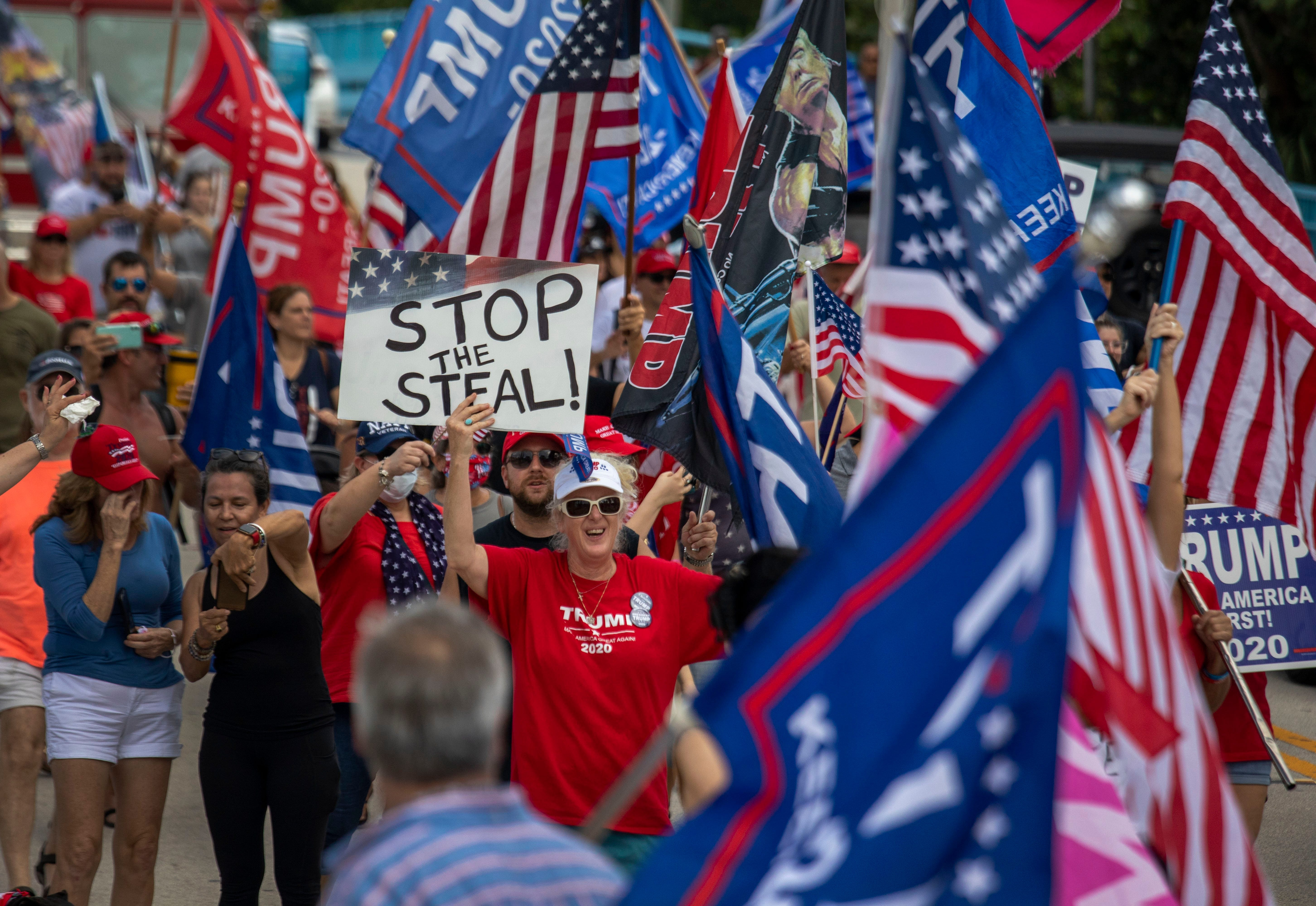 Trump supporters cheer for the President as they march along Atlantic Avenue during a Stop the Steal rally in Delray Beach, Florida on November 14, 2020. (Greg Lovett / The Palm Beach Post)Wpb 111520 Stop The St2 3