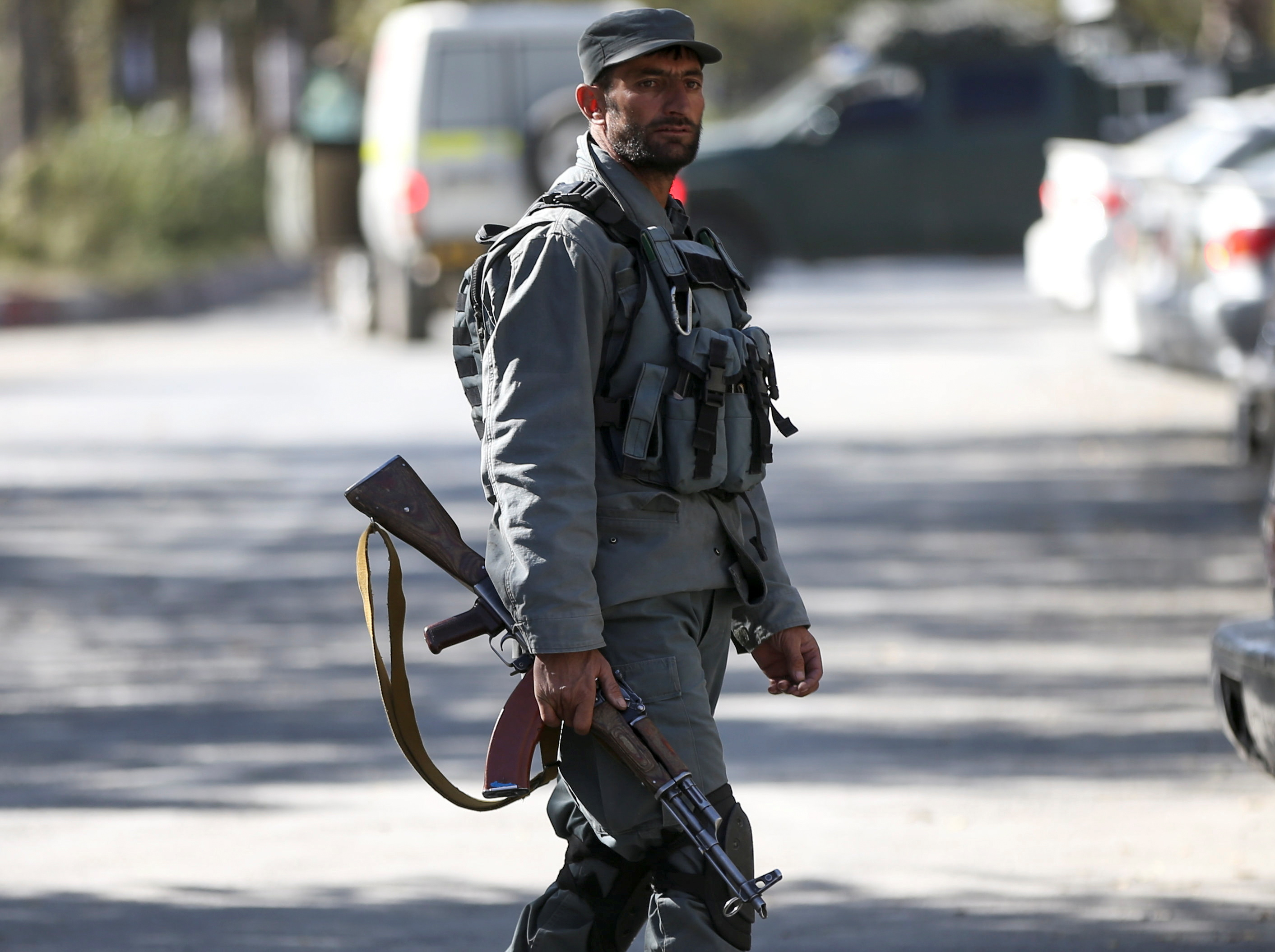 An Afghan policeman keeps watch near the site of an attack at the university of Kabul, Afghanistan November 2, 2020. REUTERS/Omar Sobhani