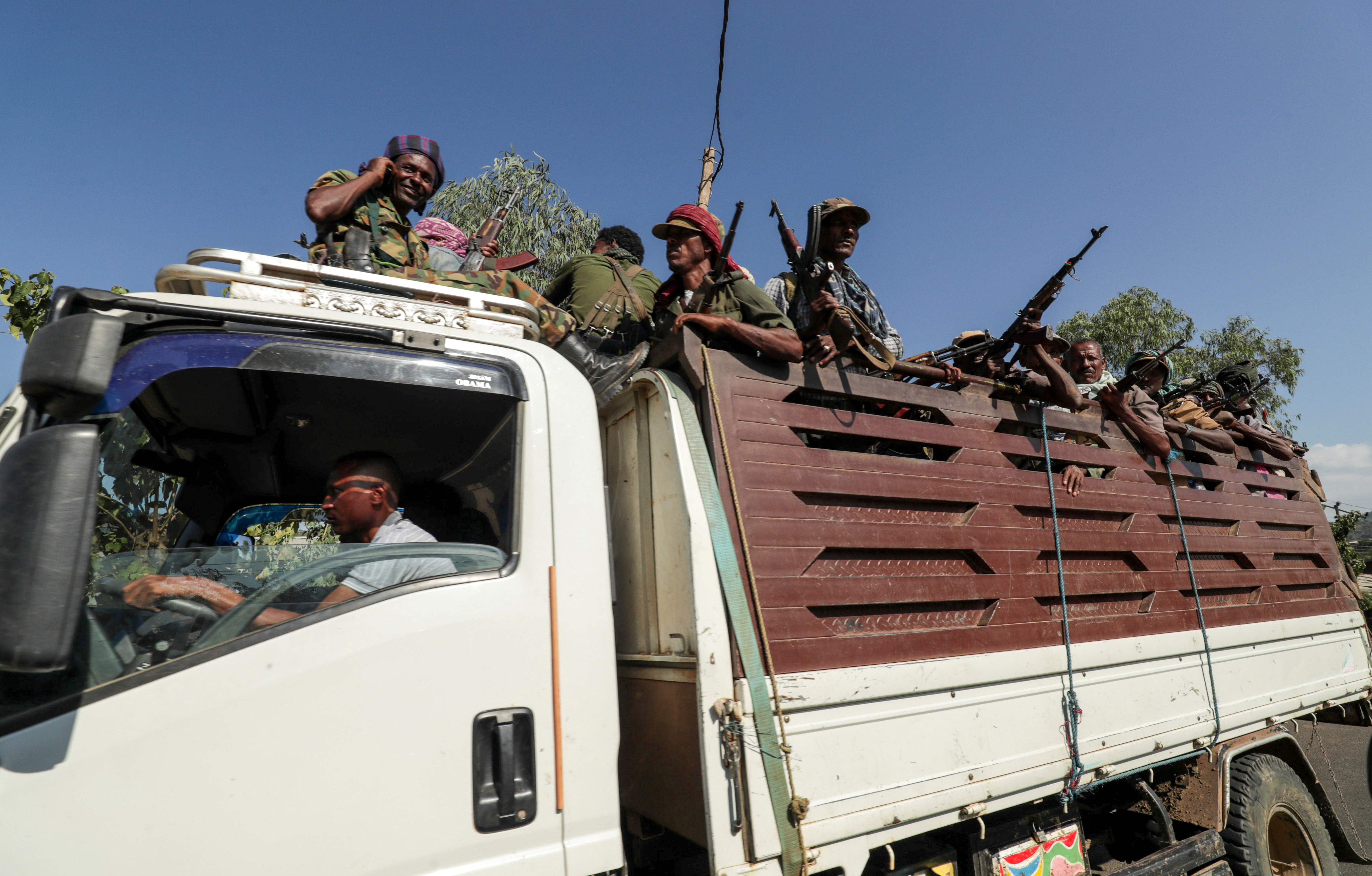 FILE PHOTO: Members of Amhara region militias ride on their truck as they head to face the Tigray People's Liberation Front (TPLF), in Sanja, Amhara region near a border with Tigray, Ethiopia November 9, 2020. REUTERS/Tiksa Negeri/File Photo