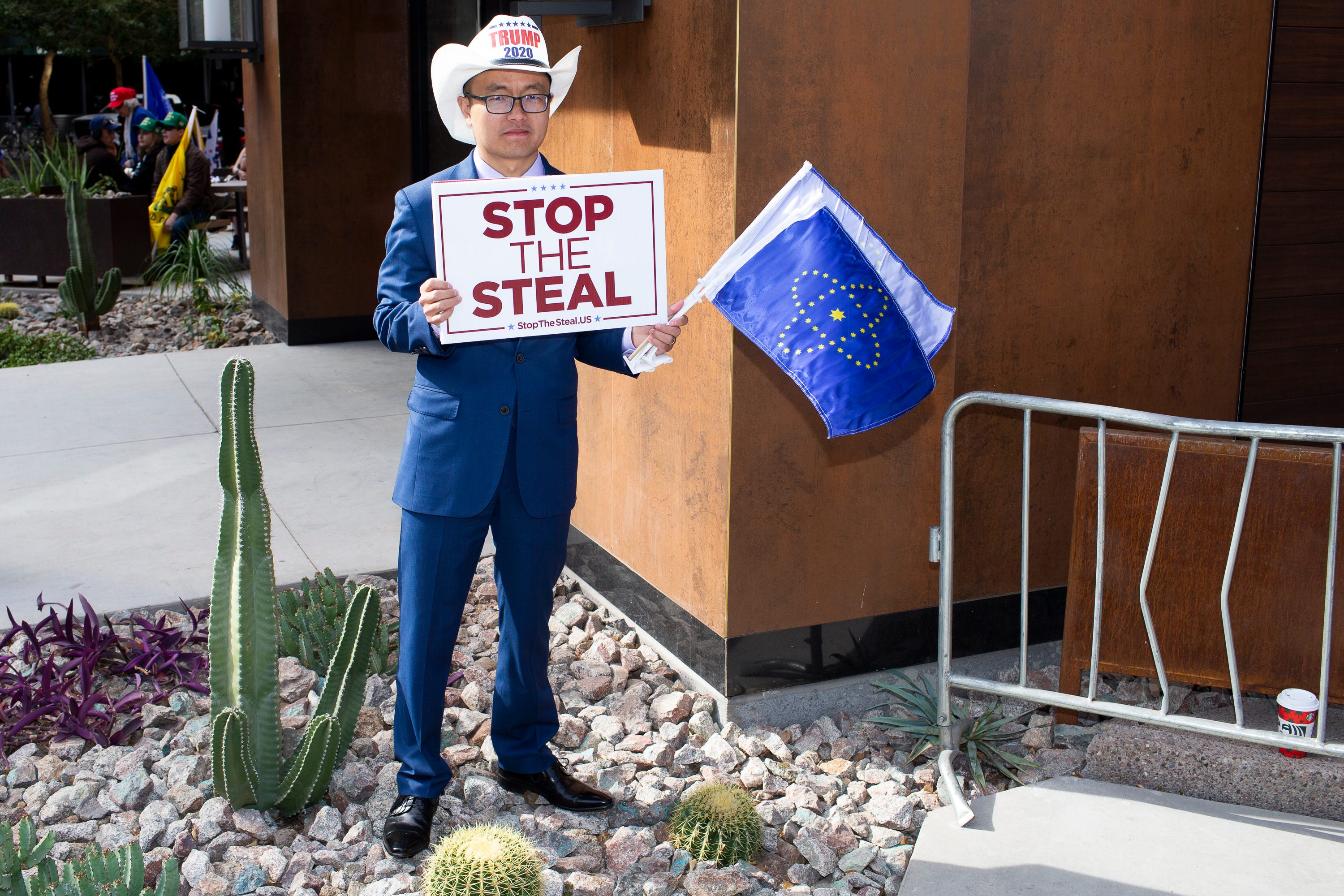 James Wang, a supporter of President Donald Trump, rallies with fellow protesters disputing President Trump's defeat in the 2020 election, citing election fraud and other concerns, outside of the Hyatt Regency Hotel in Phoenix, Arizona on Nov. 30, 2020. President Trump's attorney Rudy Giuliani held a public meeting down the street at the Hyatt Regency Hotel with state legislators and others to discuss their concerns regarding the 2020 US Presidential election.Rudy Giuliani Phoenix Stop The Steal Nov 30