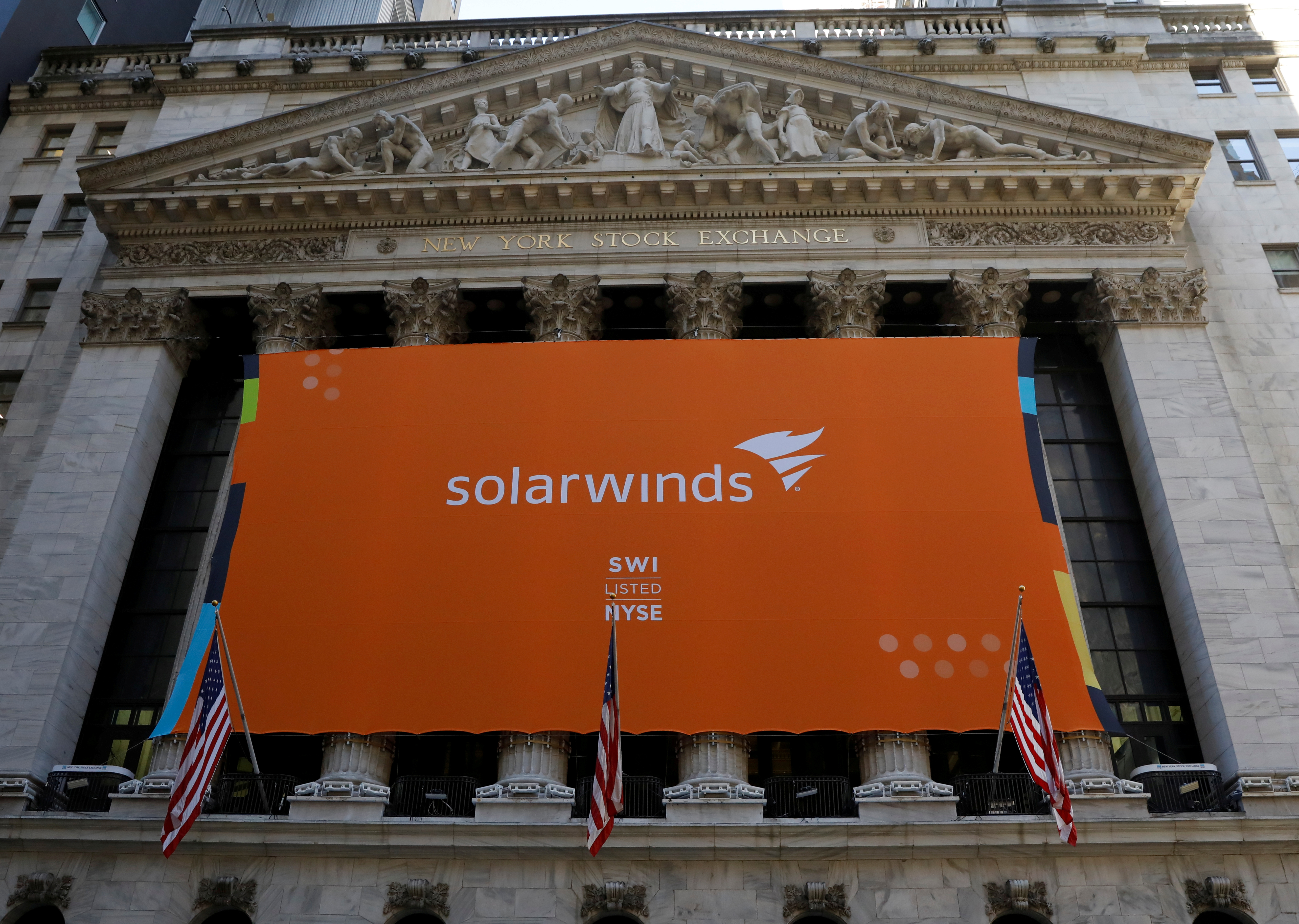 FILE PHOTO: SolarWinds Corp banner hangs at the New York Stock Exchange (NYSE) on the IPO day of the company in New York, U.S., October 19, 2018. REUTERS/Brendan McDermid/File Photo