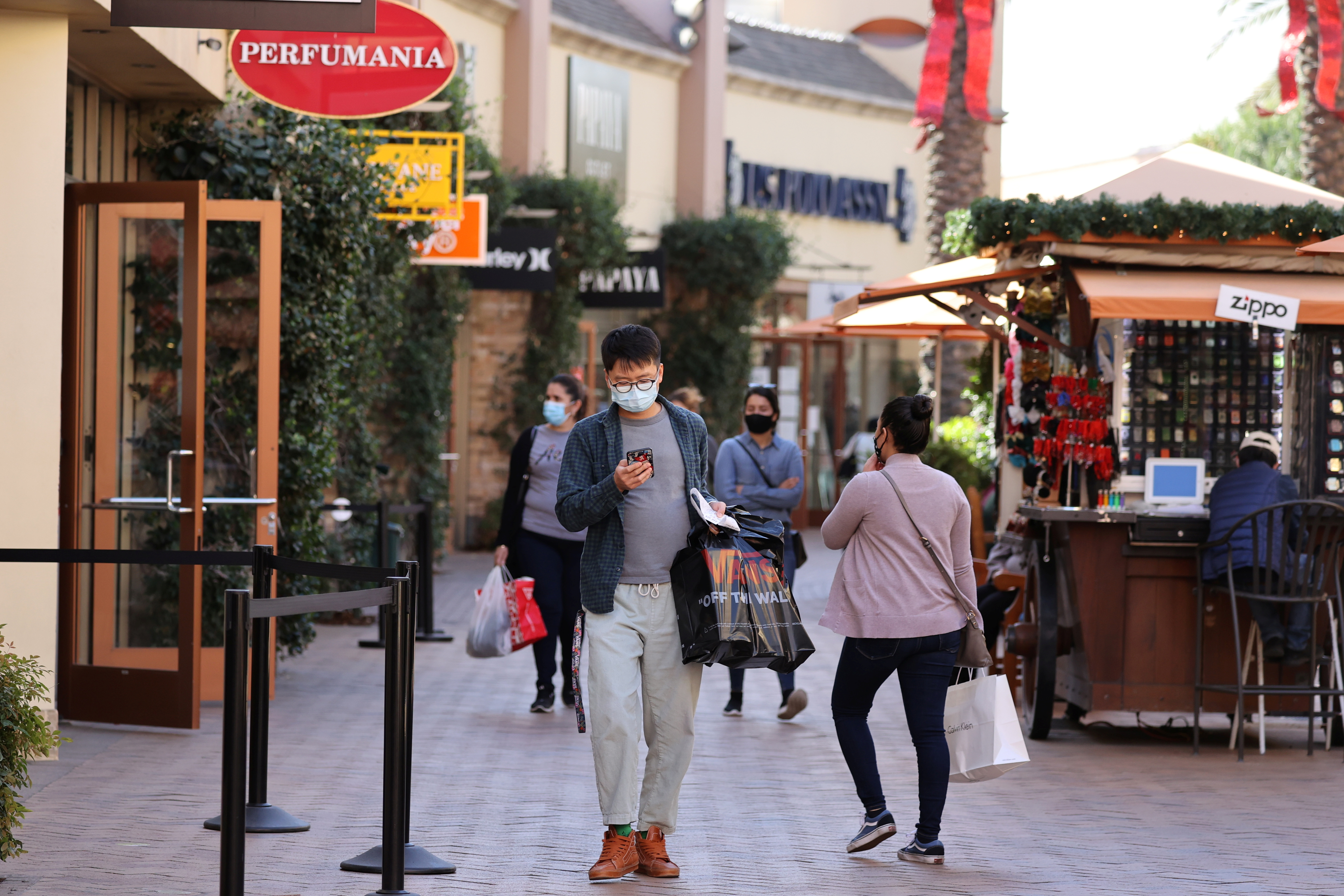 People shop at the Citadel Outlet mall, as the global outbreak of the coronavirus disease (COVID-19) continues, in Commerce, California, U.S., December 3, 2020. REUTERS/Lucy Nicholson