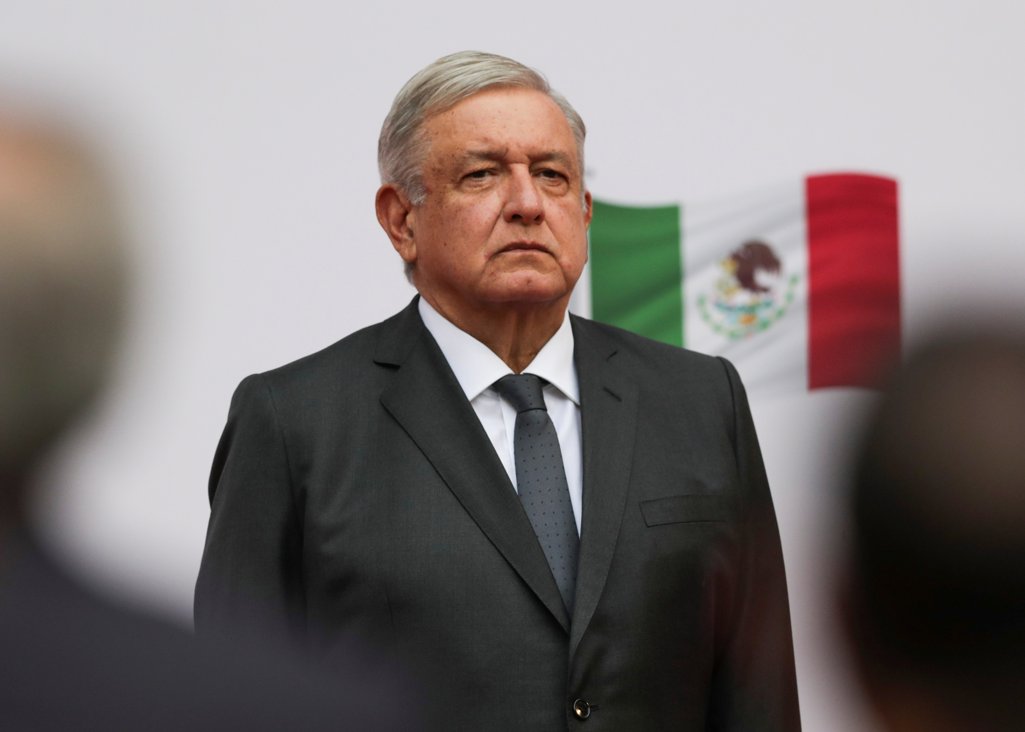 Mexico's President Andres Manuel Lopez Obrador listens to the national anthem as he arrives to address the nation on his second anniversary as President of Mexico, at the National Palace in Mexico City, Mexico, December 1, 2020. REUTERS/Henry Romero