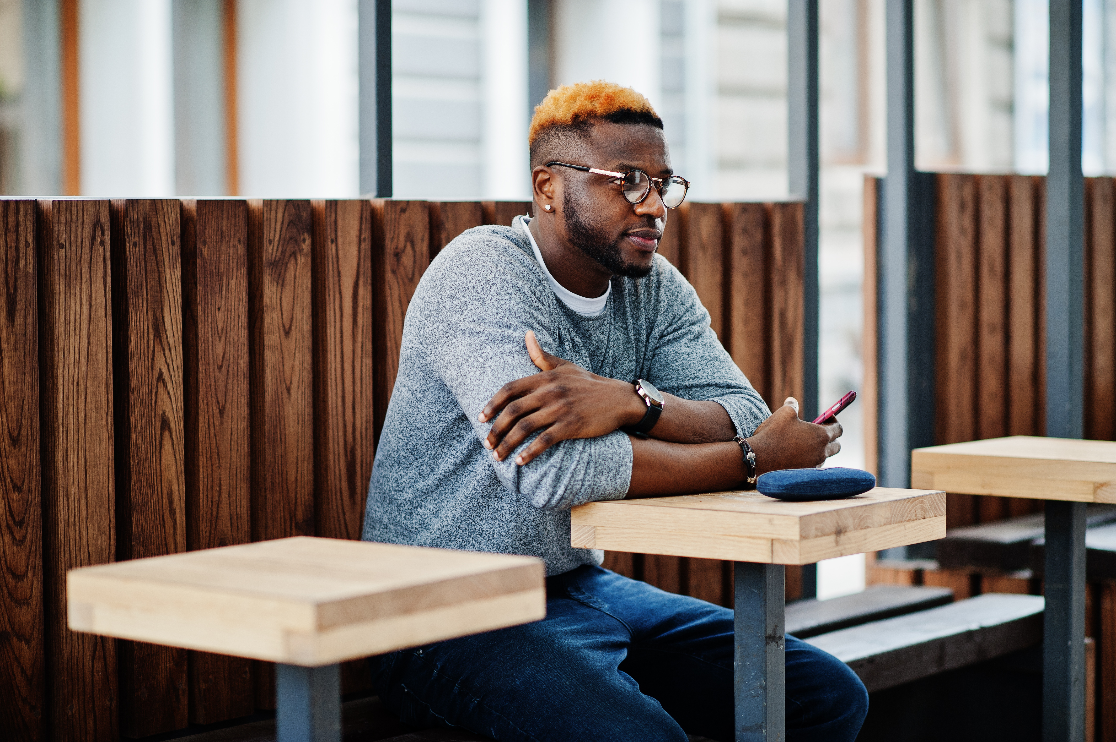 man sitting outside at table
