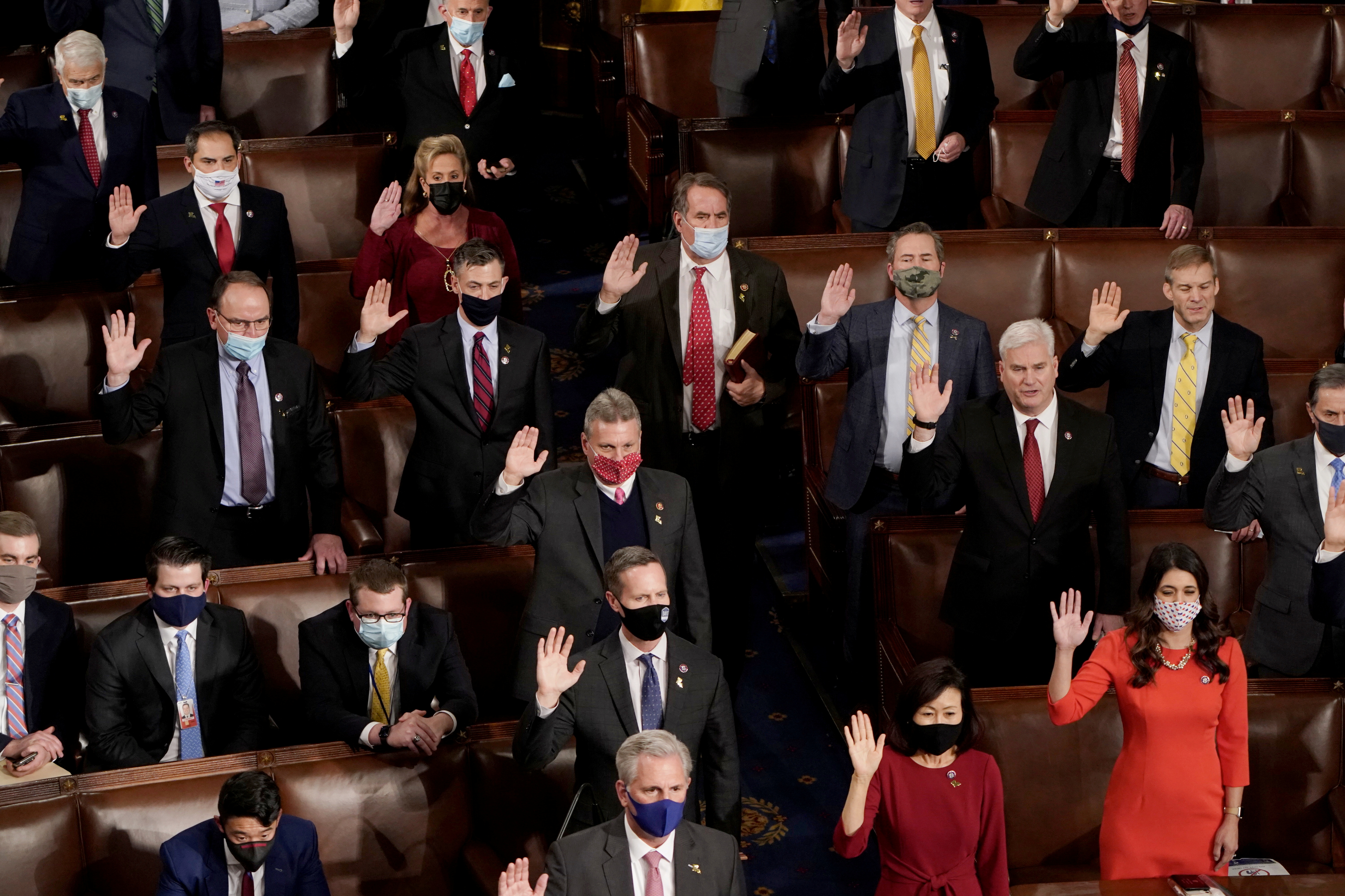 Republican members of the U.S. House of Representatives take their oath of office on the floor of the House Chamber during the first session of the 117th Congress on Capitol Hill in Washington, U.S., January 3, 2021.   REUTERS/Joshua Roberts     TPX IMAGES OF THE DAY