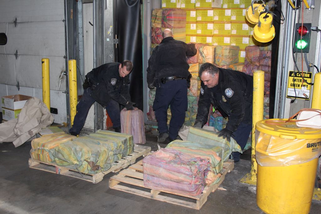 Law enforcement officers unload part of approximately 3,200 lbs. of cocaine, which was seized at the Port of New York/Newark on February 28, 2019 in a joint operation involving U.S. Customs and Border Protection (CBP), the U.S. Coast Guard (USCG), Homeland Security Investigations (HSI), the Drug Enforcement Administration (DEA), the New York Police Department (NYPD), and the New York State Police (NYSP), in Newark, New Jersey, U.S., in this image released on March 11, 2019.   Courtesy U.S. Customs and Border Protection/Handout via REUTERS   ATTENTION EDITORS - THIS IMAGE HAS BEEN SUPPLIED BY A THIRD PARTY.