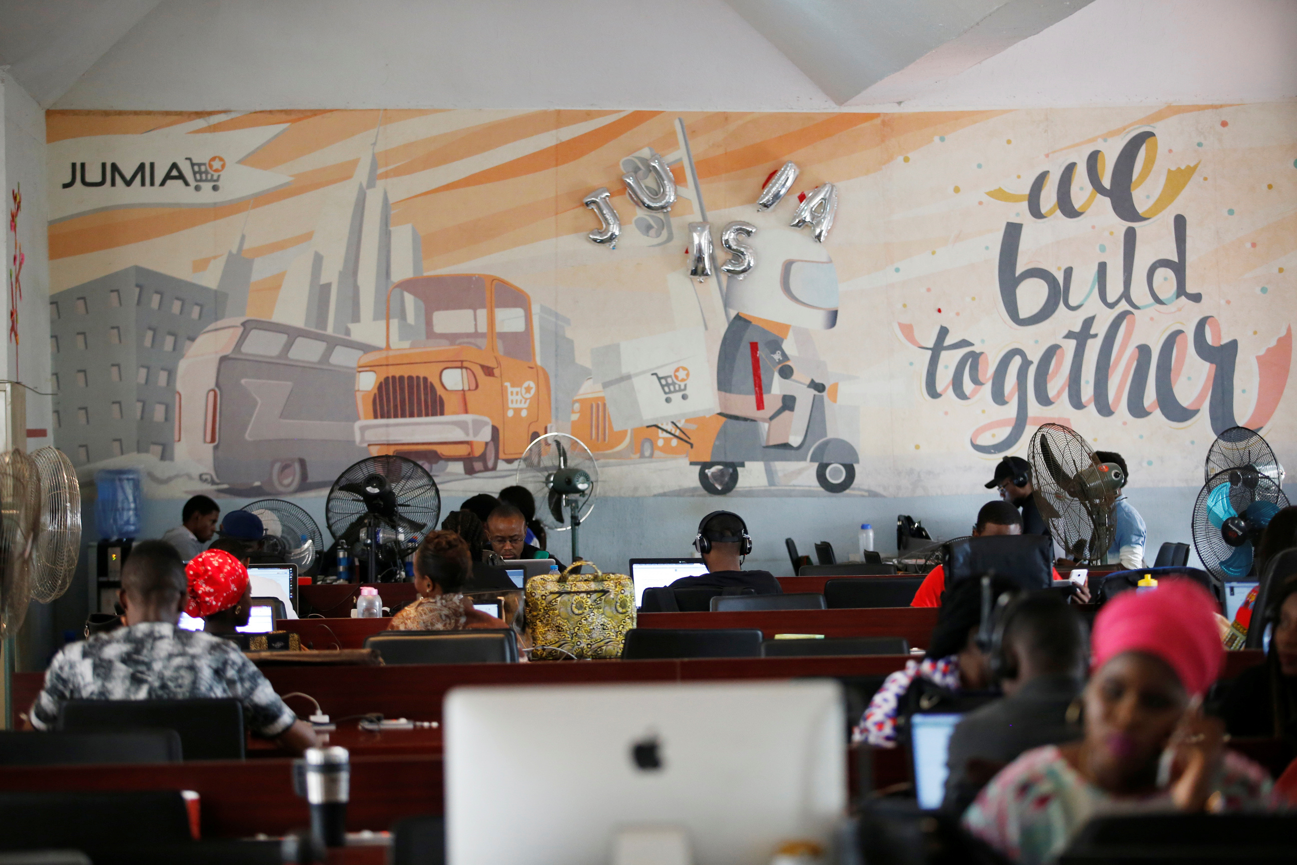 People work on computers at the online store Jumia in Ikeja district, in Nigeria's commercial capital Lagos June 10, 2016.REUTERS/Akintunde Akinleye