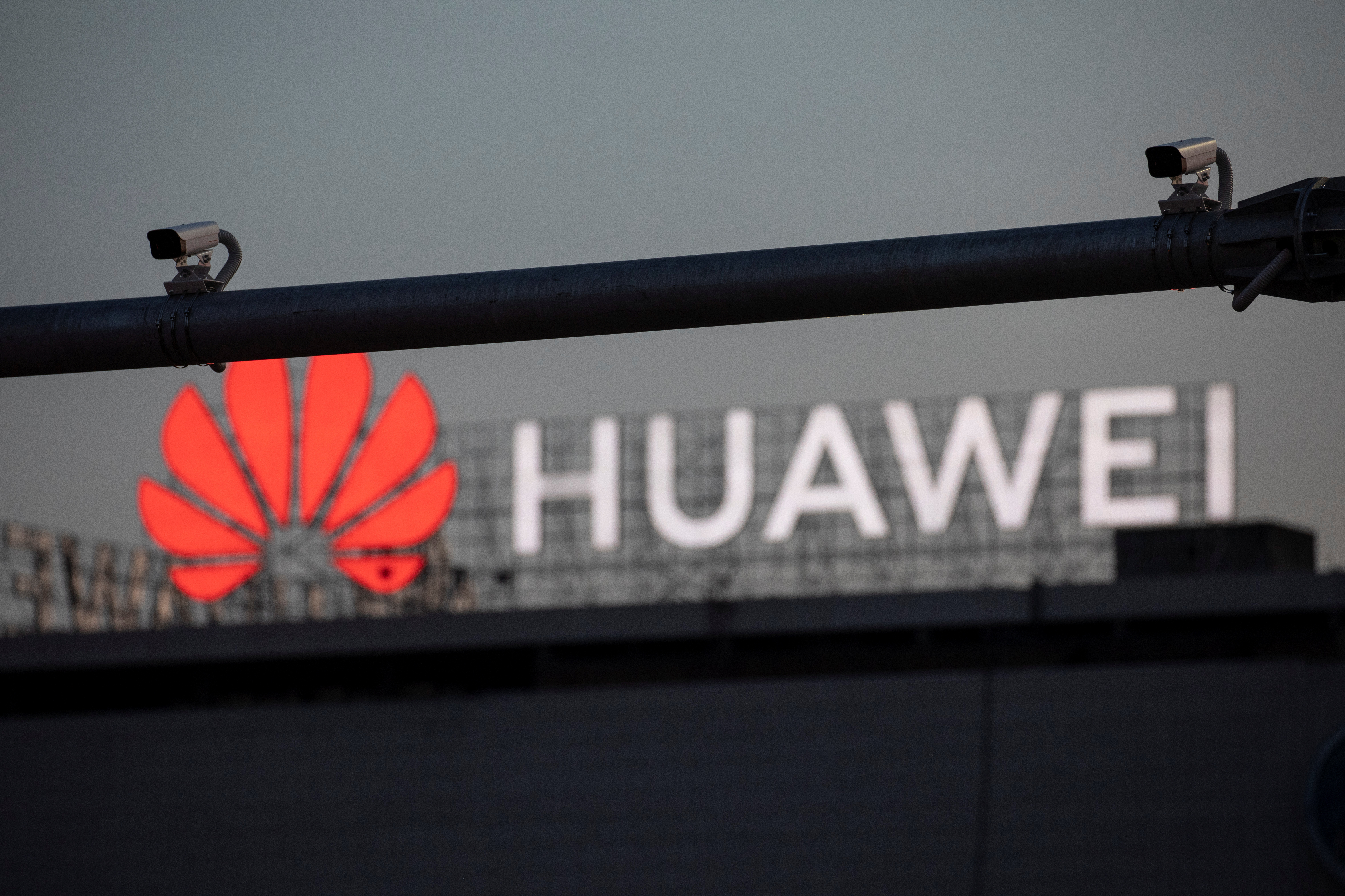 Surveillance cameras are seen in front of a Huawei logo in Belgrade, Serbia, August 11, 2020. Picture taken August 11, 2020. REUTERS/Marko Djurica