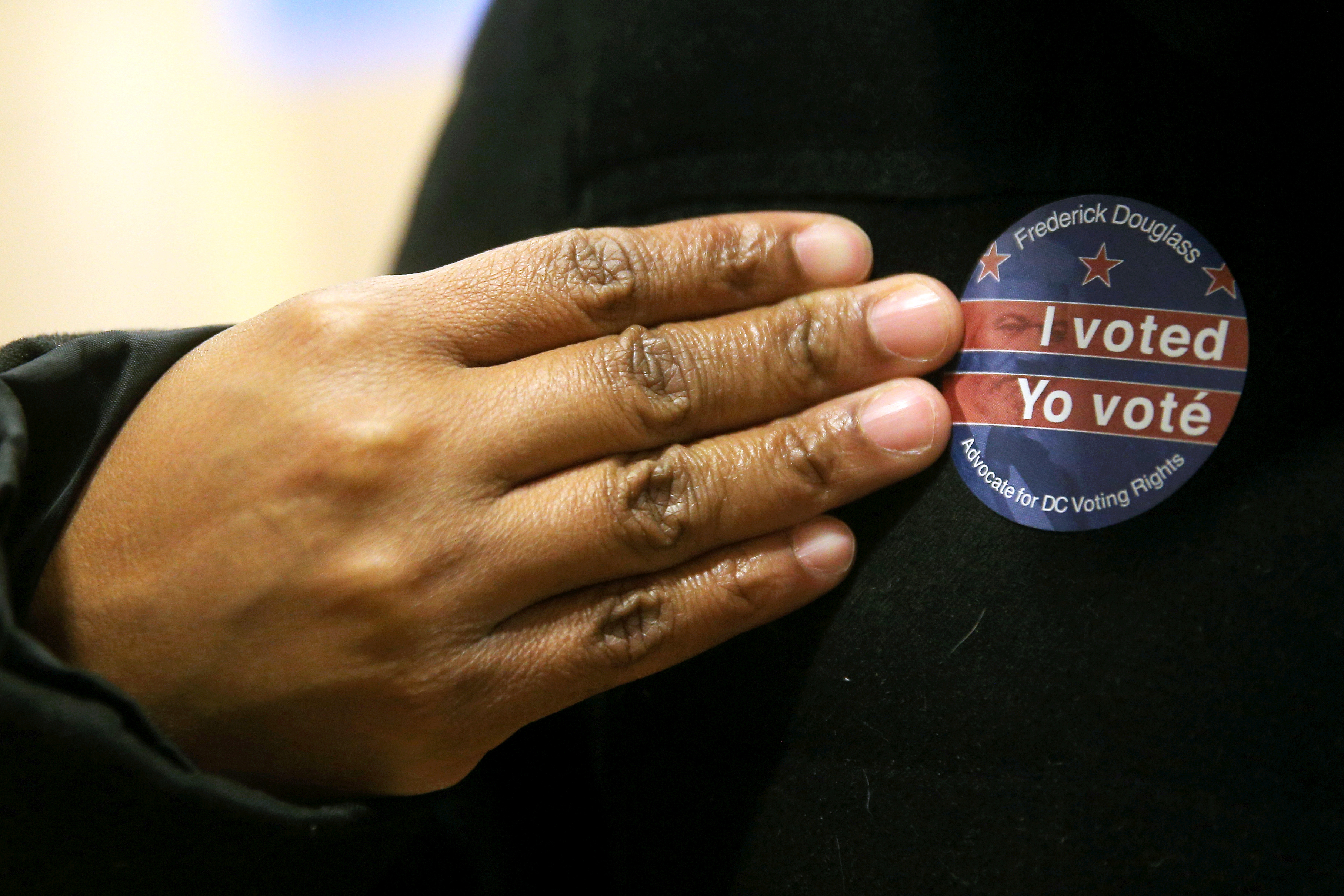 WASHINGTON D.C., UNITED STATES — NOVEMBER 2, 2020: A voter wears a bilingual I voted sticker at the University of the District of Columbia (UDC) during early voting in the 2020 US presidential election. Yegor Aleyev/TASS.No use Russia.