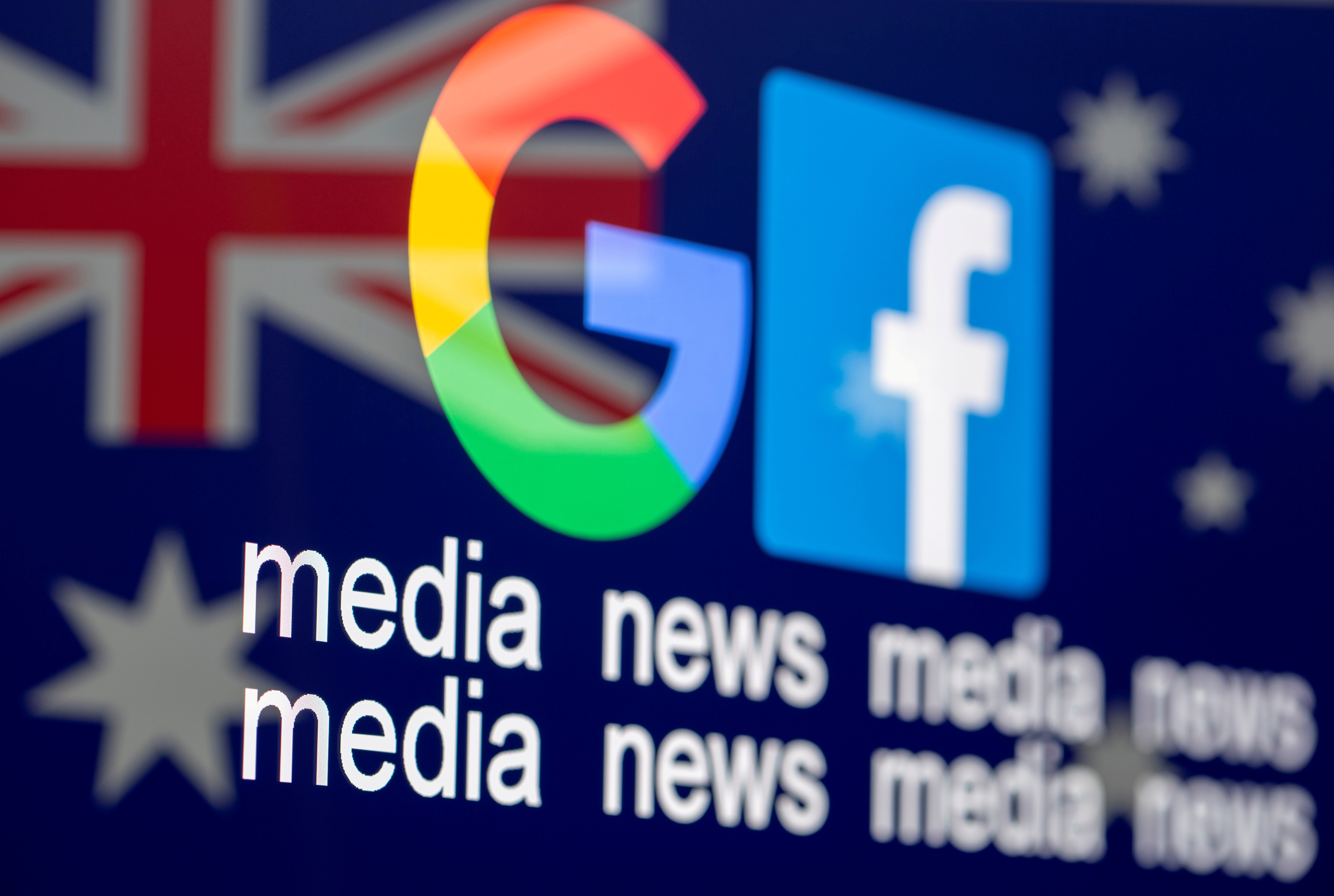 "FILE PHOTO: FILE PHOTO: The Google and Facebook logos, the words ""media, news, media"" and the Australian flag are displayed in this illustration photo taken February 18, 2021. REUTERS/Dado Ruvic/Illustration/File Photo/File Photo"