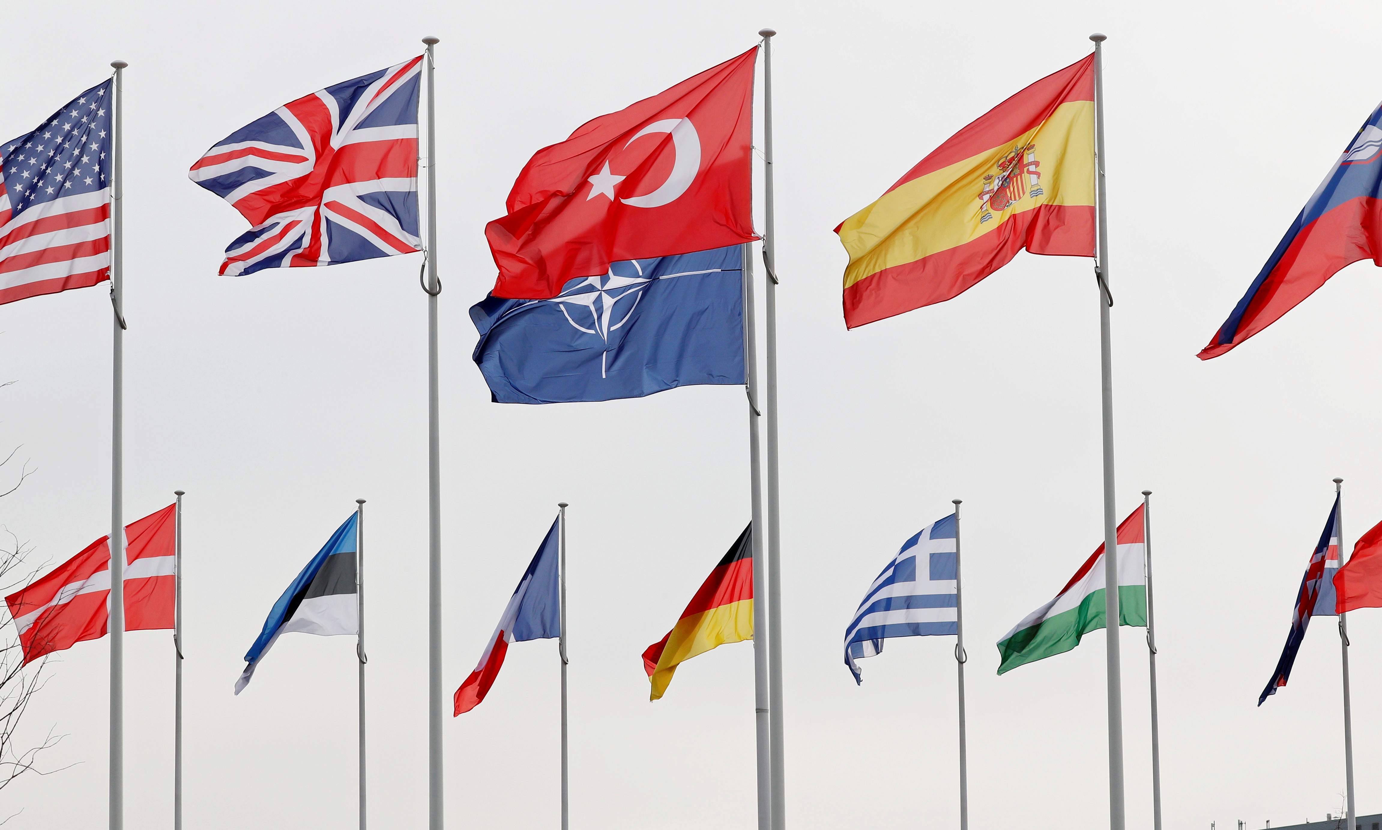Flags of NATO member countries flutter at the Alliance headquarters in Brussels, Belgium, February 28, 2020.  REUTERS/Francois Lenoir
