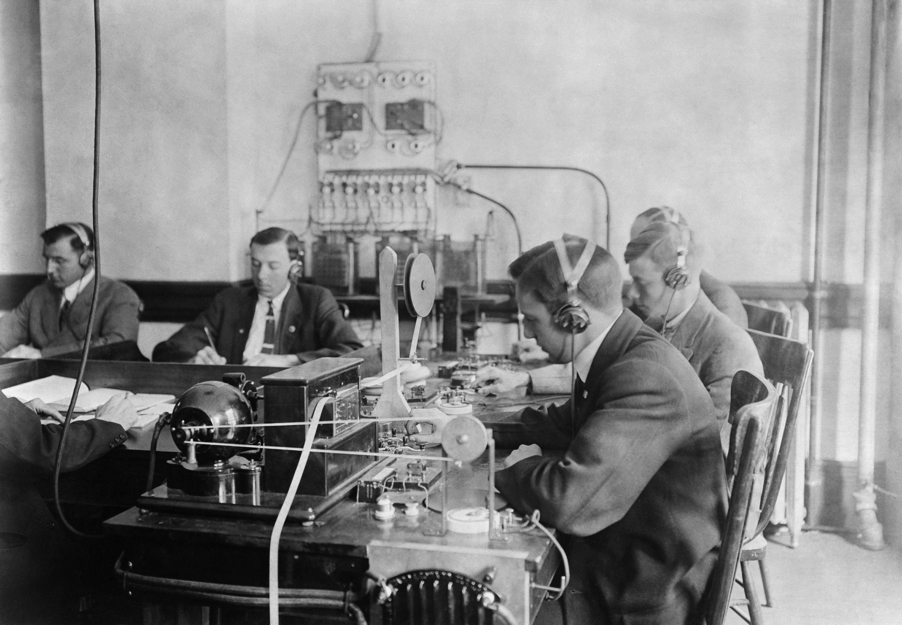 Students practicing telegraphy at the Marconi wireless school in New York City. Ca. 1912.