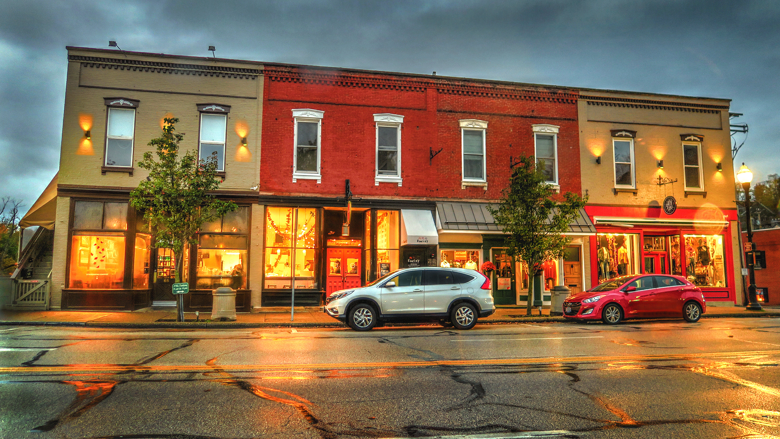 Chagrin Falls, Ohio / USA - October 29, 2017: Rainy Evening View of Starbucks, Jeni's, and Outfitters Shops on Main Street in the Business District of Historical Downtown Chagrin Falls, Ohio