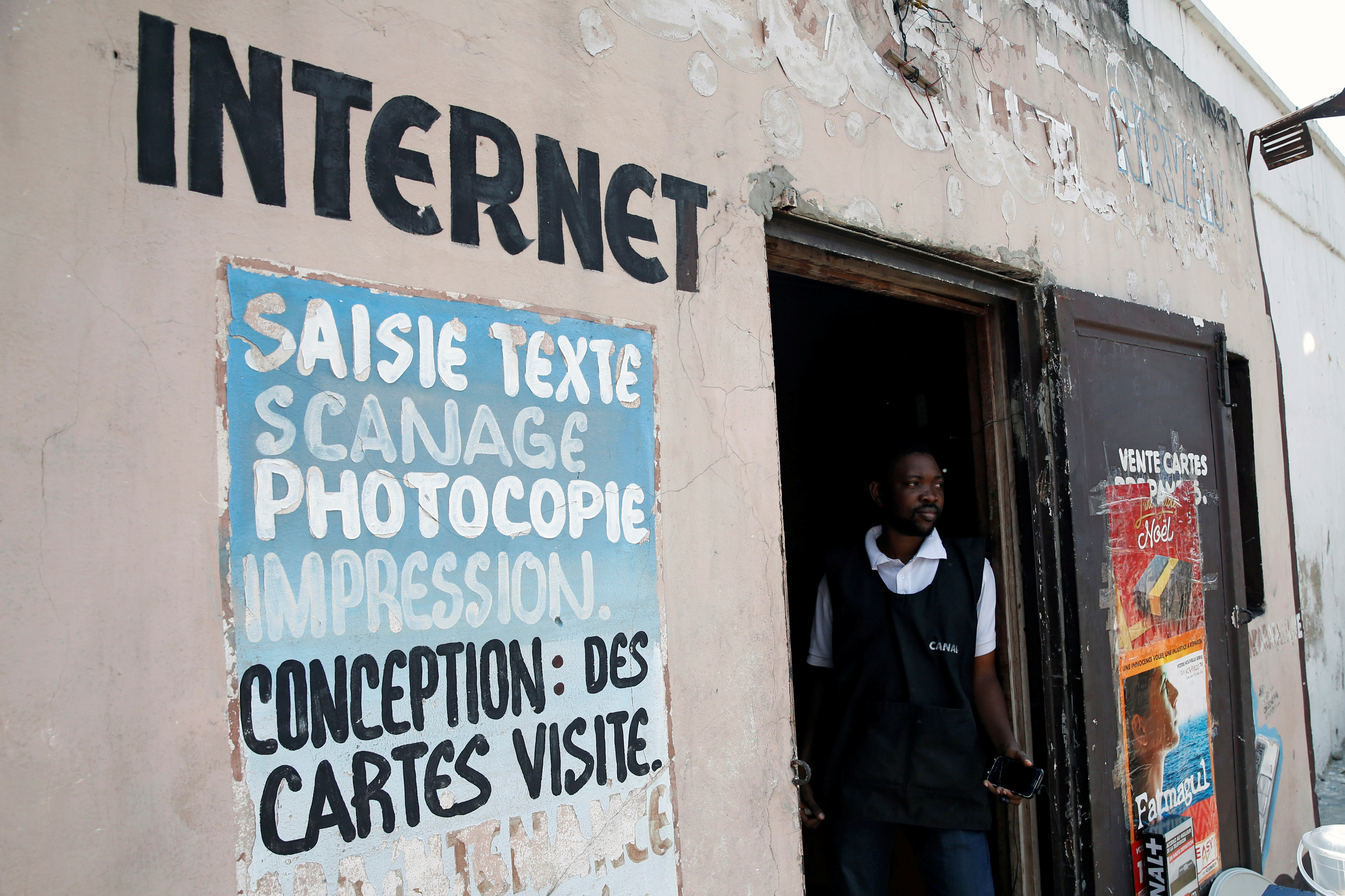 Congolese internet cafe owner Theo stands at the entrance of his empty business in Kinshasa, Democratic Republic of Congo, January 7, 2019. REUTERS/Baz Ratner