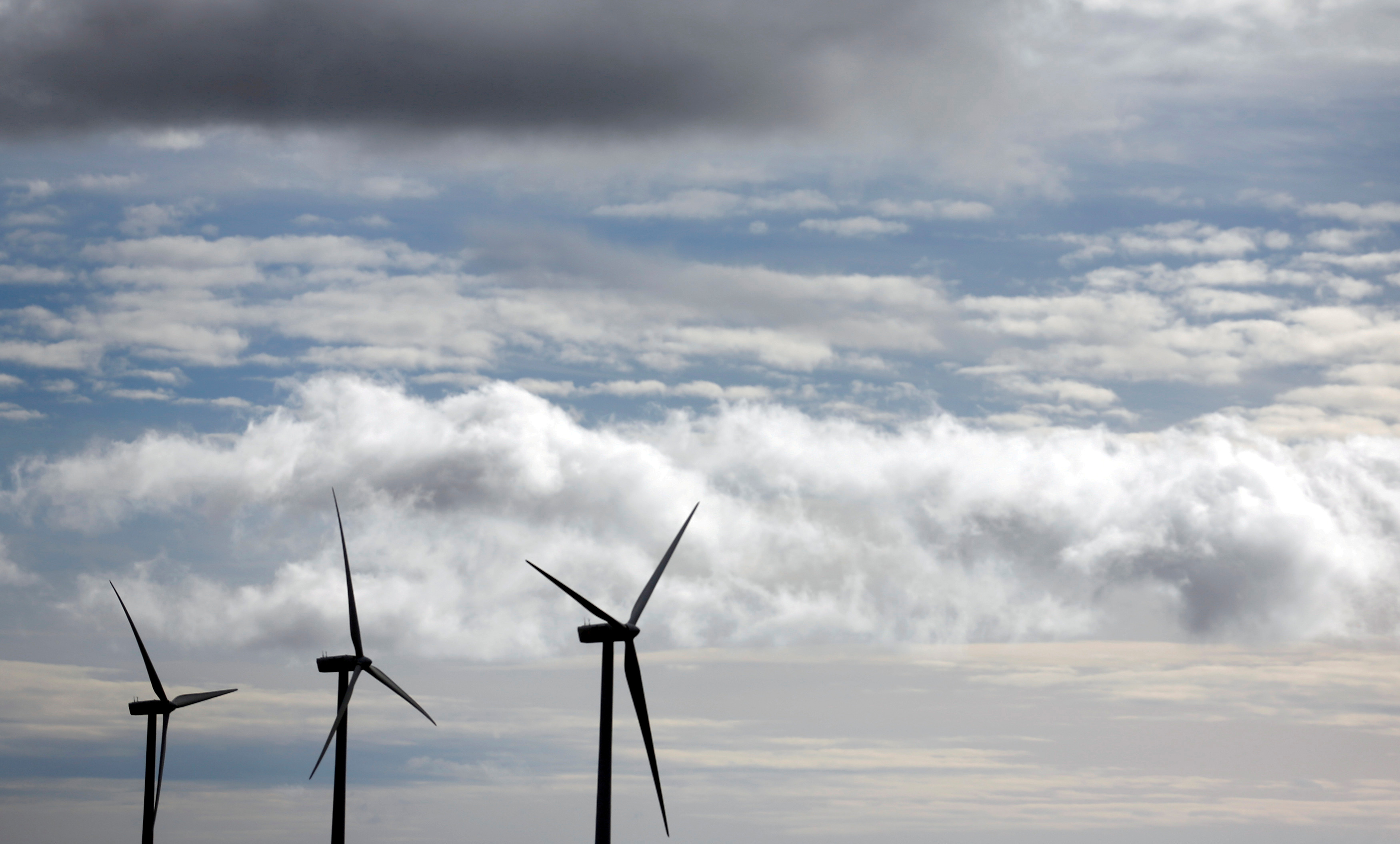 FILE PHOTO: Iberdrola's power generating wind turbines are seen against cloudy sky at Moranchon wind farm in central Spain December 17, 2012.   REUTERS/Sergio Perez/File Photo