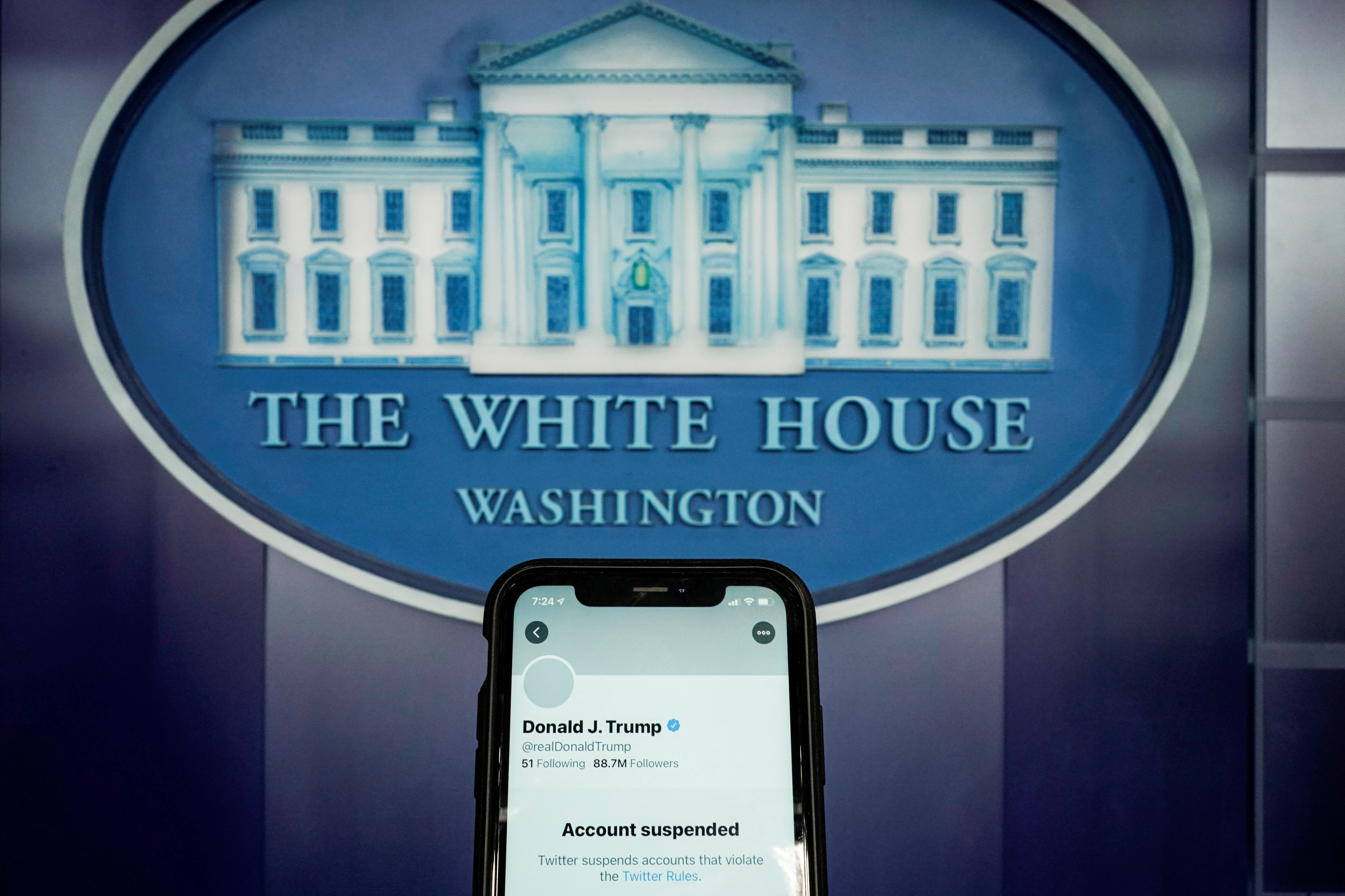 FILE PHOTO: A photo illustration shows the suspended Twitter account of former U.S. President Donald Trump on a smartphone at the White House briefing room in Washington, U.S., January 8, 2021.  REUTERS/Joshua Roberts/Illustration/File Photo
