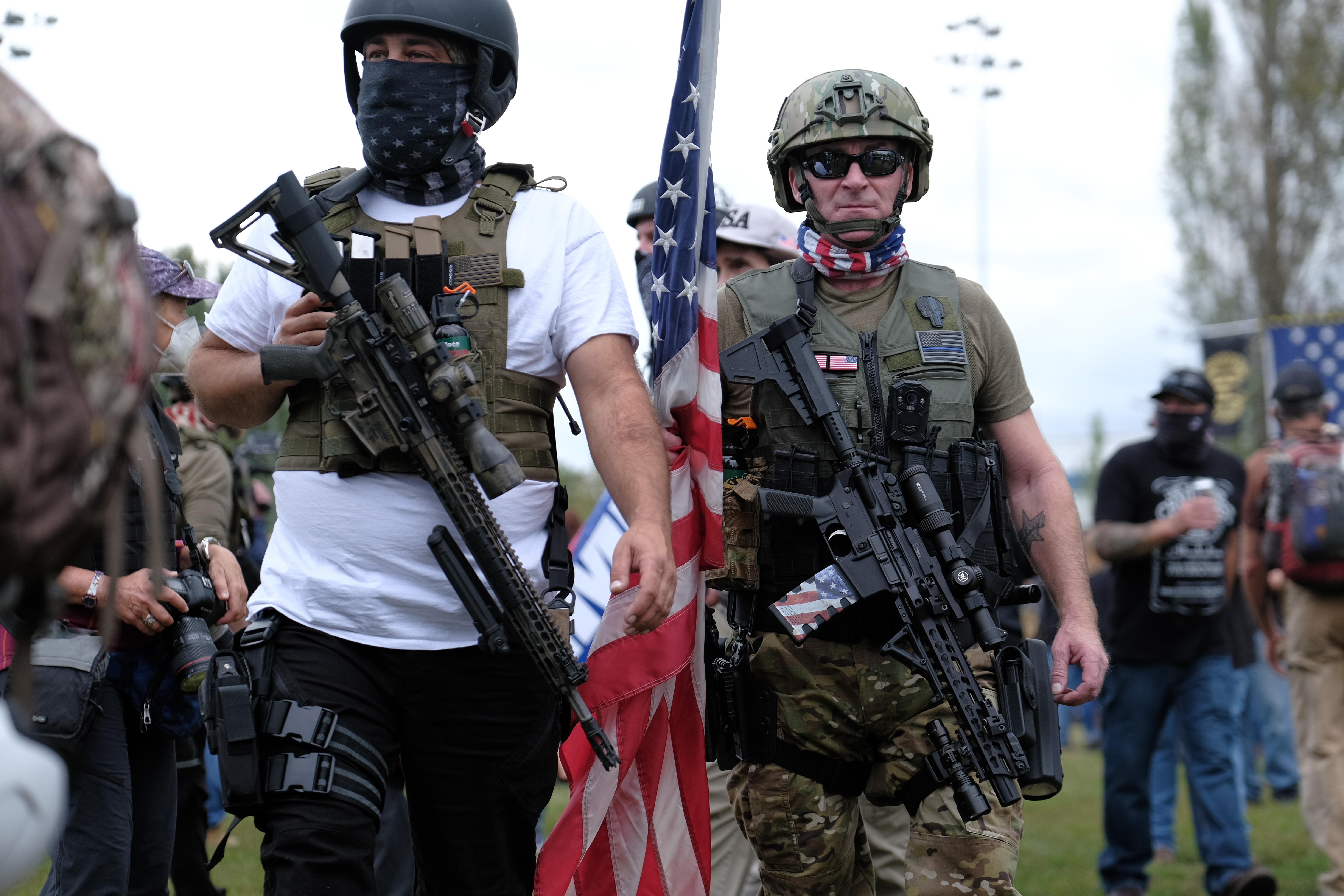 Proud Boys carry assault rifles as they gather in Portland, Ore., at Delta Park on September 26, 2020, in support of Kenosha shooter Kyle Rittenhouse and Aaron 'Jay' Danielson who was shot dead by an antifascist protester during the ongoing Black Lives Matter protests in the city. (Photo by Alex Milan Tracy/Sipa USA)No Use UK. No Use Germany.