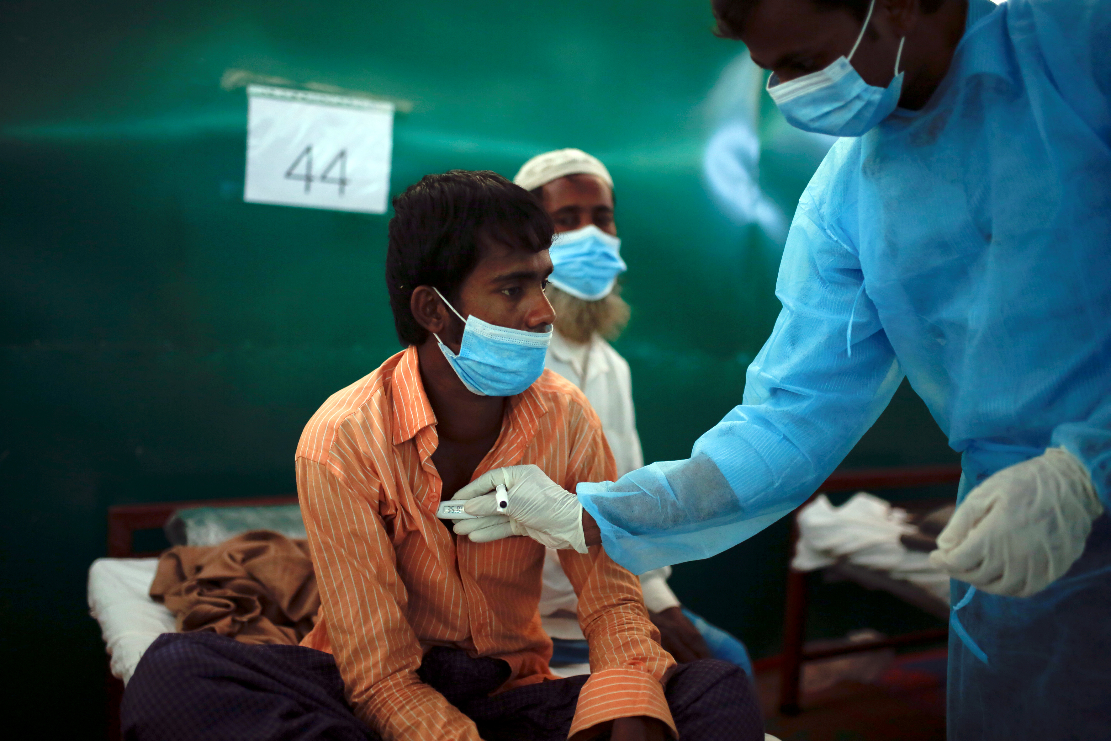 Rohingya refugee Nur Islam, 24, who suffers from diphtheria, is examined by a doctor at a Medecins Sans Frontieres (MSF) clinic near Cox's Bazar, Bangladesh December 18, 2017. According to the World Health Organisation (WHO) from November 3 through December 12, a total of 804 suspected diphtheria cases including 15 deaths were reported among the displaced Rohingya population in Cox's Bazar. REUTERS/Alkis Konstantinidis