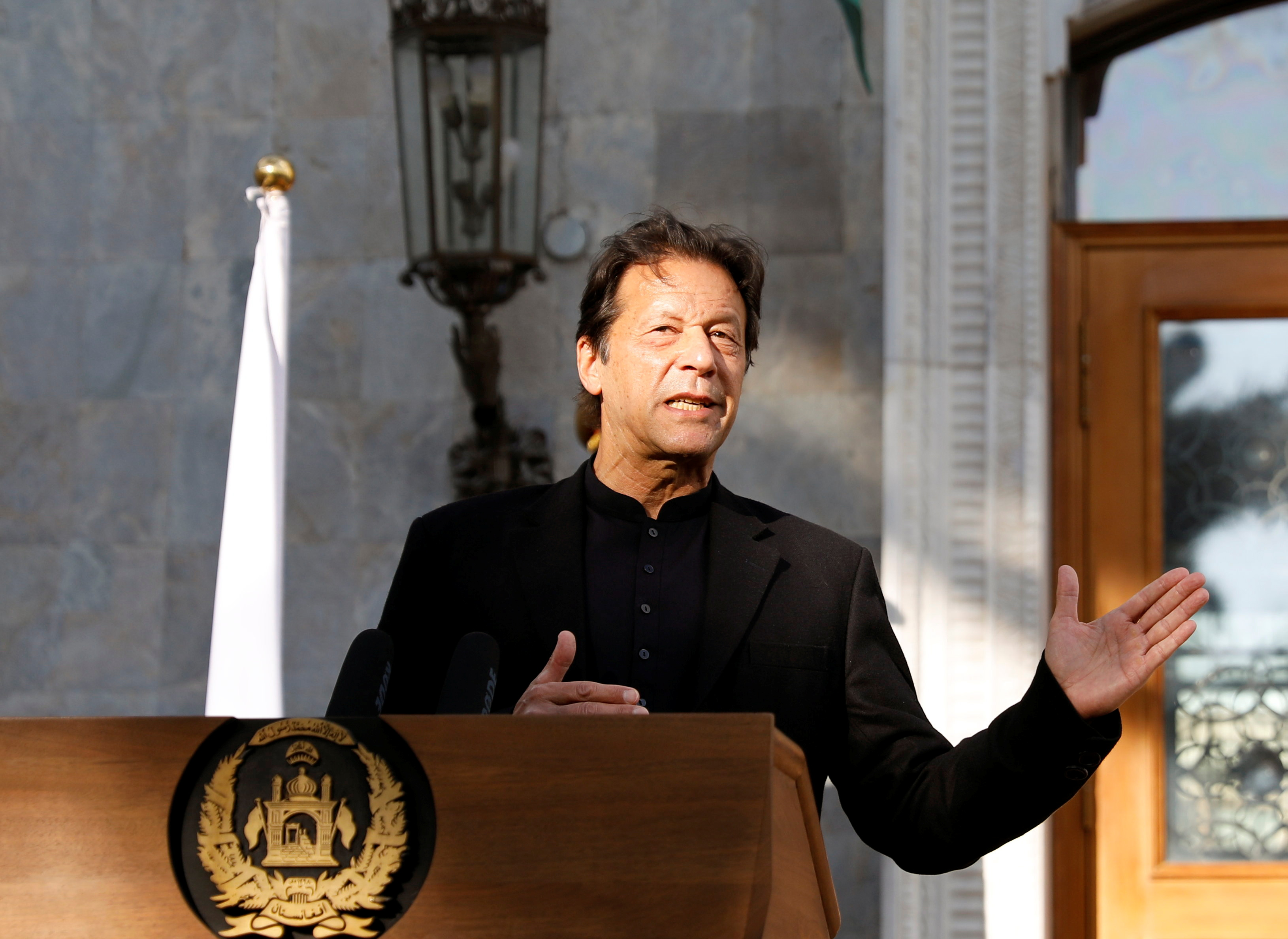 Pakistan's Prime Minister Imran Khan speaks during a joint news conference with Afghan President Ashraf Ghani (not pictured) at the presidential palace in Kabul, Afghanistan November 19, 2020. REUTERS/Mohammad Ismail