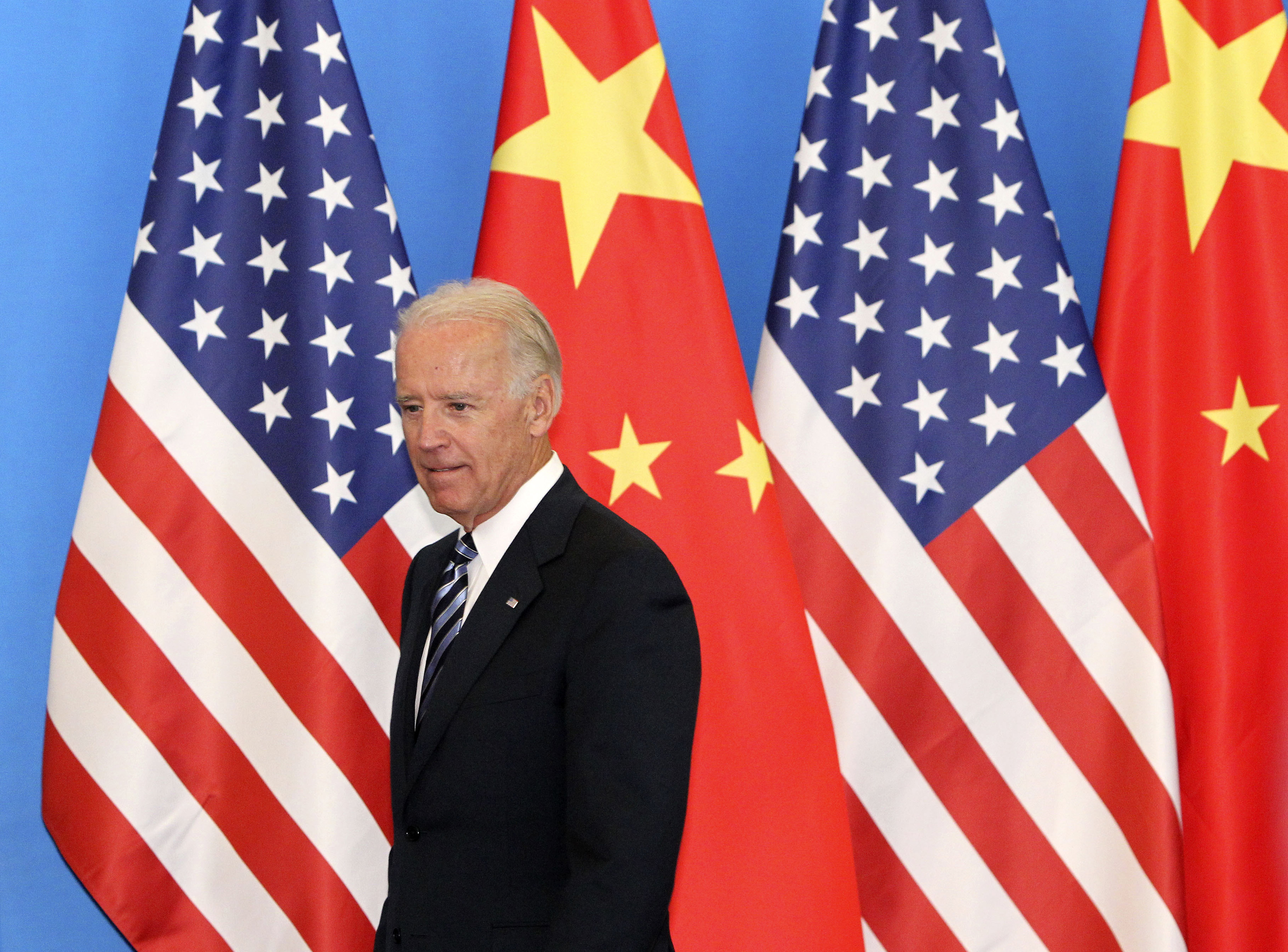 "U.S. Vice-President Joe Biden arrives with his Chinese counterpart Xi Jinping (not pictured) at a China-US Business Dialogue in the Beijing Hotel in Beijing August 19, 2011. China and the United States ""have a responsibility to strengthen macro-economic policy coordination and together boost market confidence,"" Xi told visiting Biden on Thursday, according to Chinese state media. REUTERS/How Hwee Young/Pool (CHINA - Tags: POLITICS)"