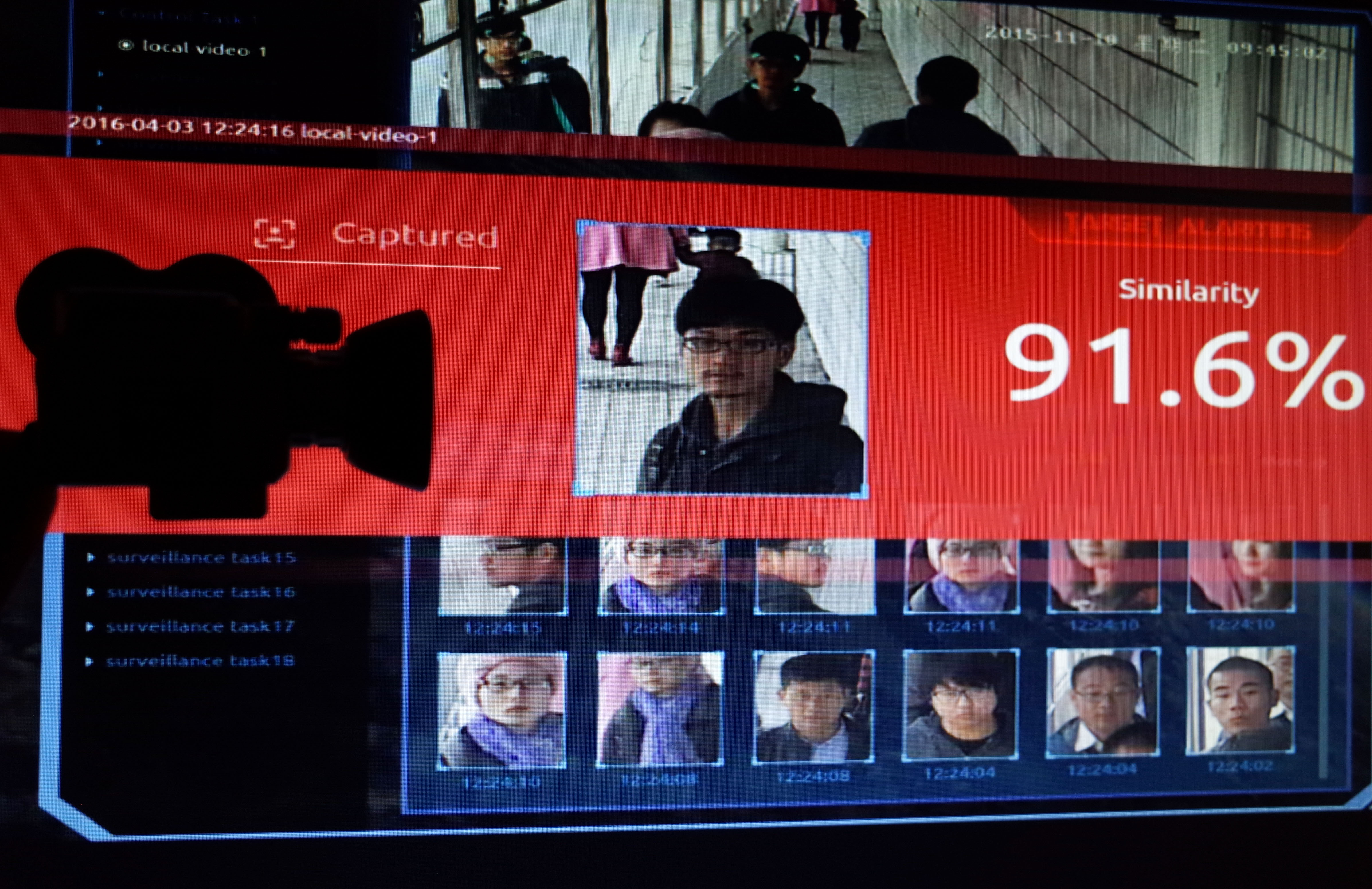 February 05, 2020:  Illustration of China's facial-recognition technology with the silhouette of a mock video camera in front of screen grabs taken from a promotional video by SenseTime. SenseTime is a Chinese artificial intelligence company whose SenseFace software is specialised in facial recognition. Photo d'illustration de la technologie de reconnaissance faciale en Chine.NO USE FRANCE