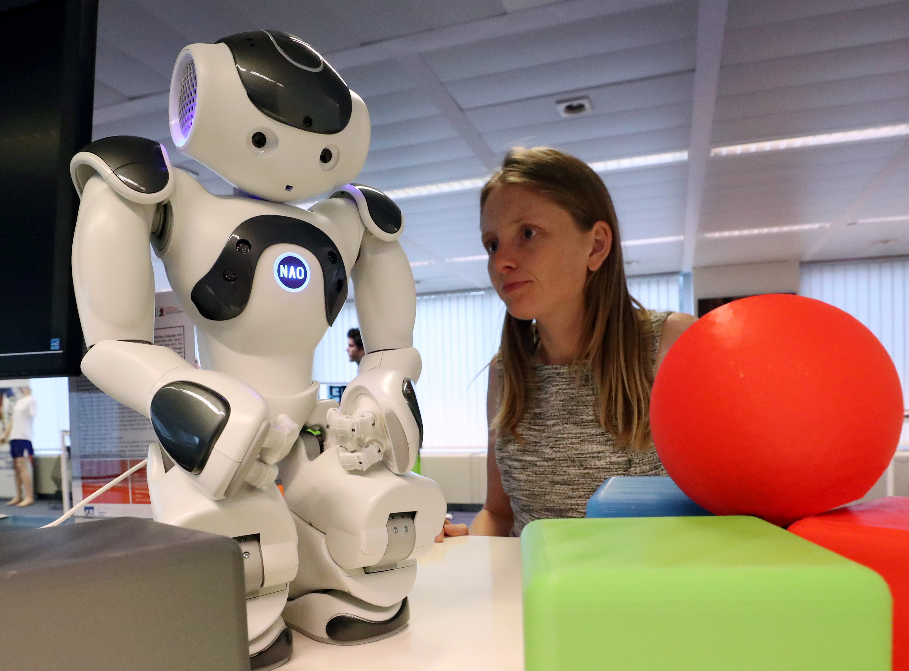 Marjon Blondeel, AI R&D developer, looks at a robot equipped with artificial Intelligence at the AI Xperience Center at the VUB (Vrije Universiteit Brussel) in Brussels, Belgium February 19, 2020.  REUTERS/Yves Herman