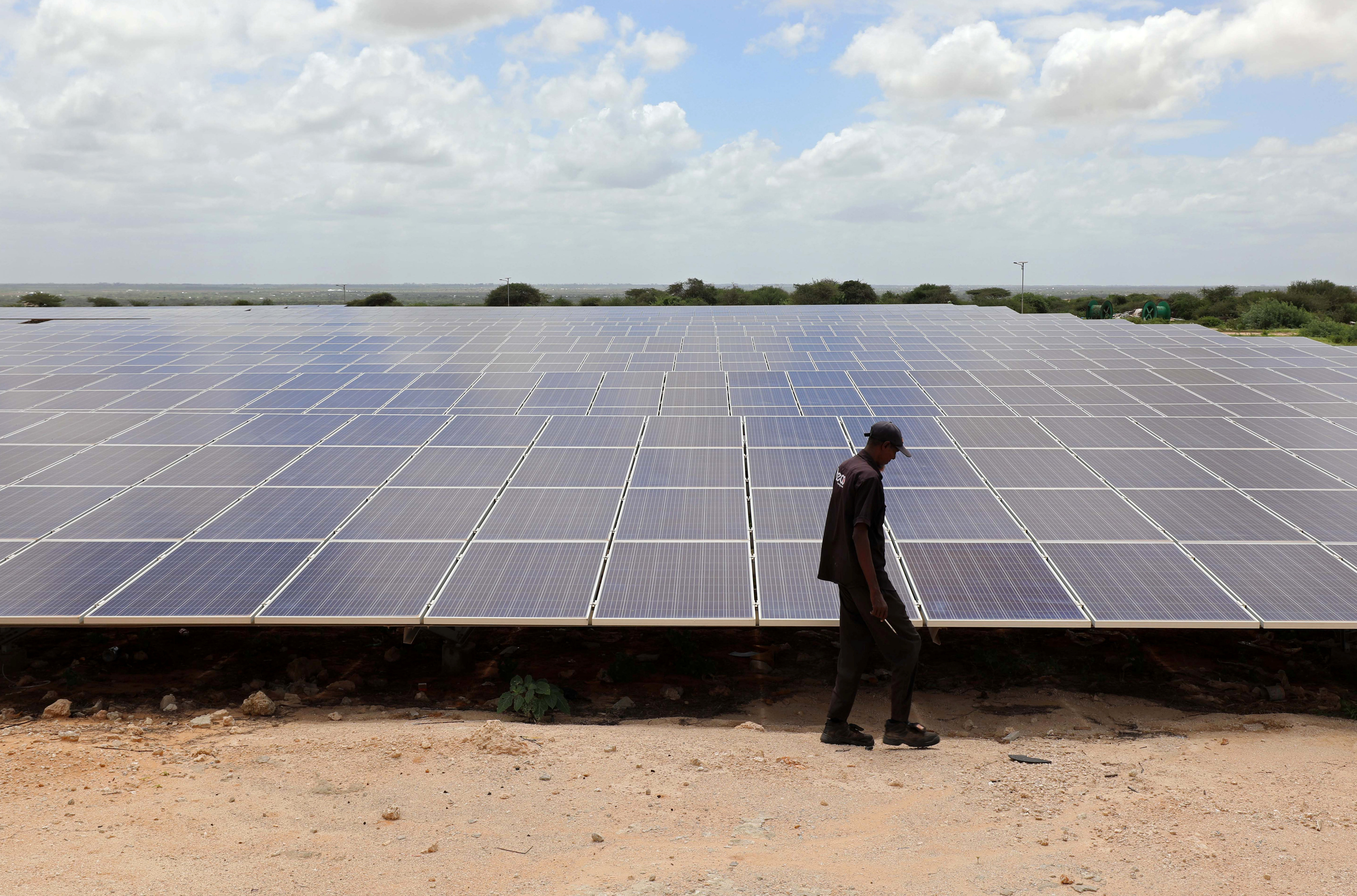 A engineer walks past the solar panels at the Benadir Electricity Company (BECO) solar project in Mogadishu, Somalia May 21, 2020. Picture taken May 21, 2020. REUTERS/Feisal Omar