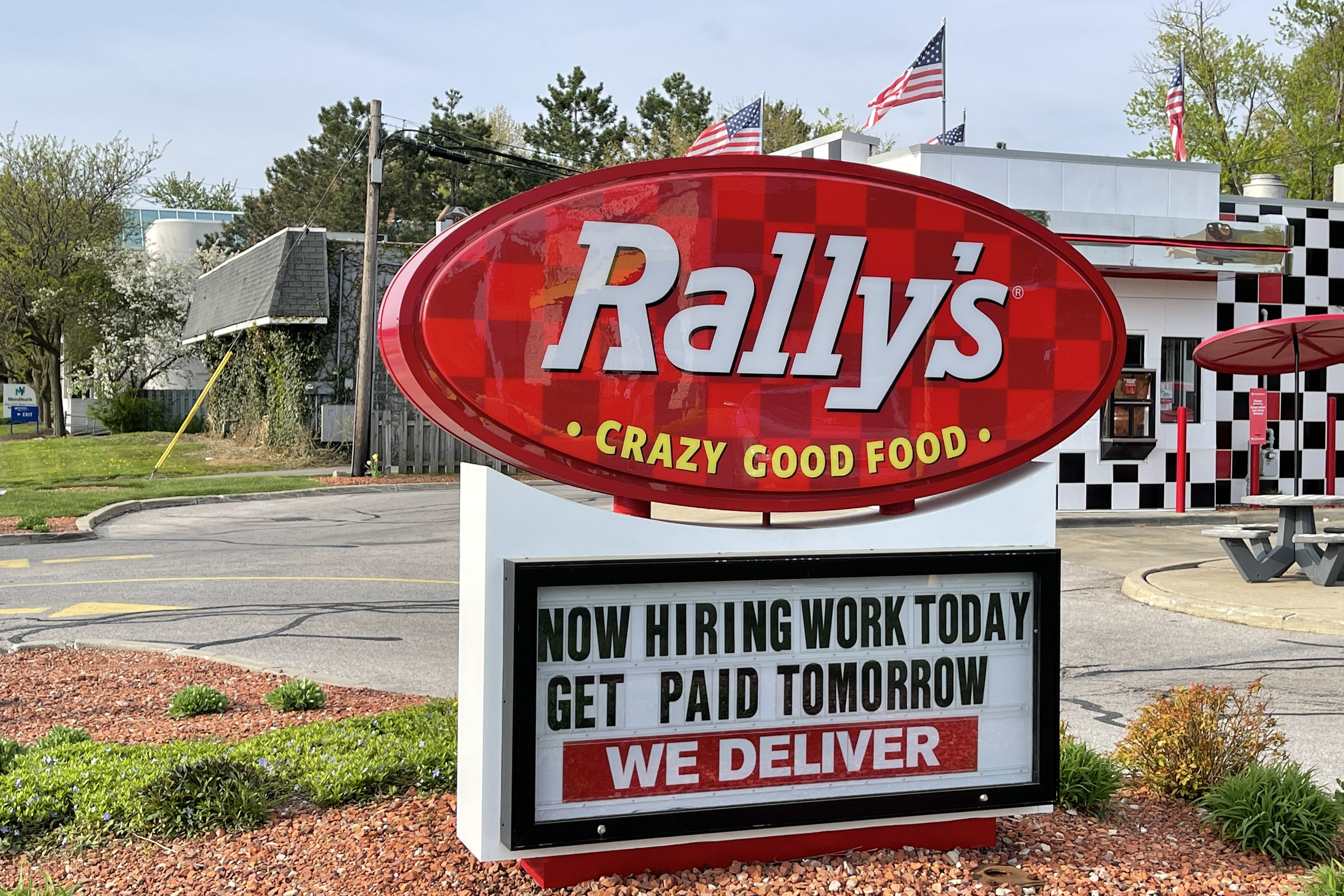 A Now Hiring sign at Rally's Drive-In restaurant, Wednesday, April 28, 2021, in Cleveland.  (Photo by Image of Sport/Sipa USA)No Use Germany.