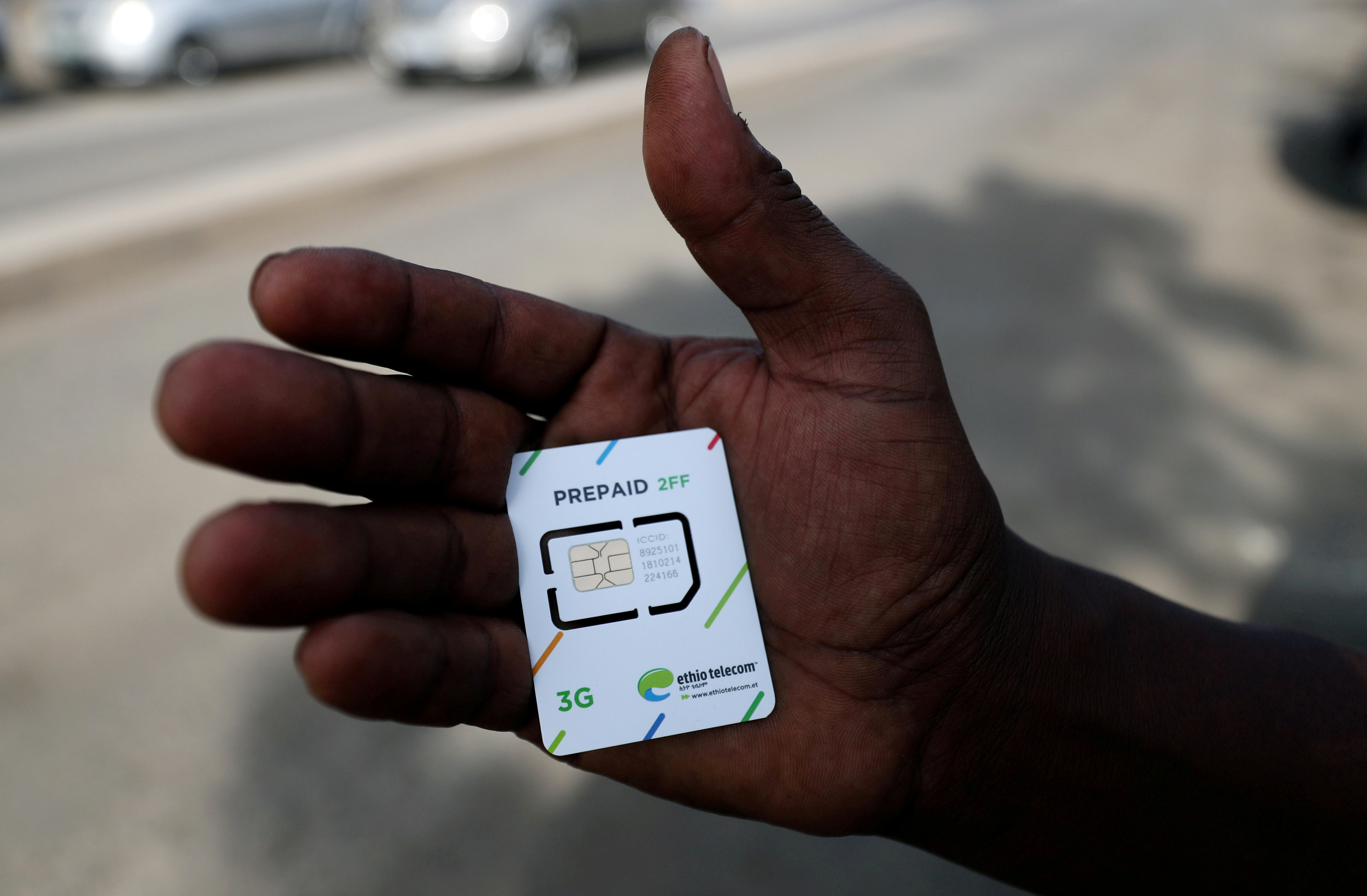 FILE PHOTO: A customer holds a 3G prepaid sim card after buying the service from an Ethio-Telecom shop in Addis Ababa, Ethiopia, November 12, 2019. REUTERS/Tiksa Negeri/File Photo