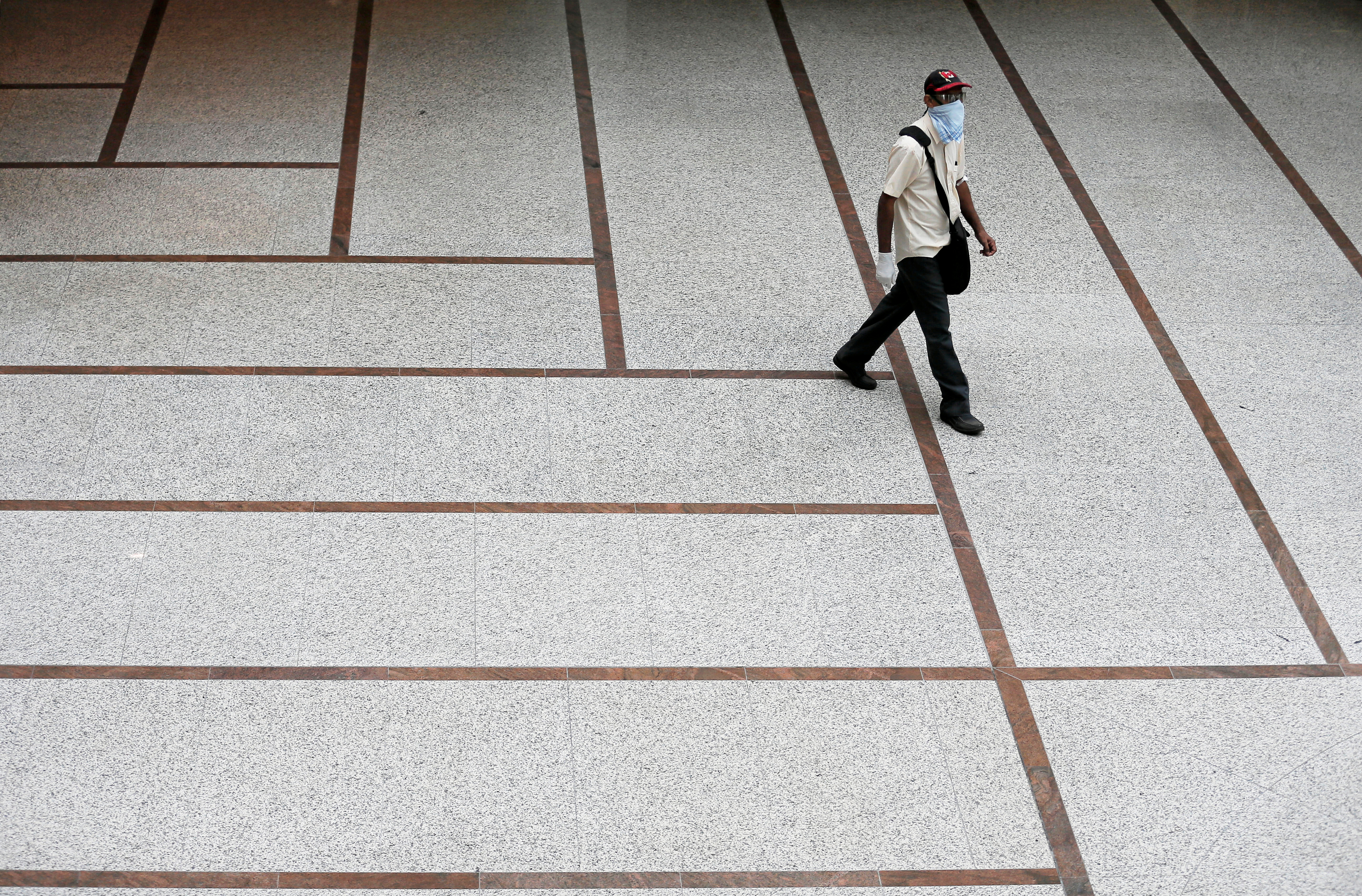 A man walks inside the World Trade Center after the government announced that private and state companies will reopen their offices after almost two months of lockdown amidst concerns about the spread of coronavirus disease (COVID-19) in Colombo, Sri Lanka May 11, 2020. REUTERS/Dinuka Liyanawatte