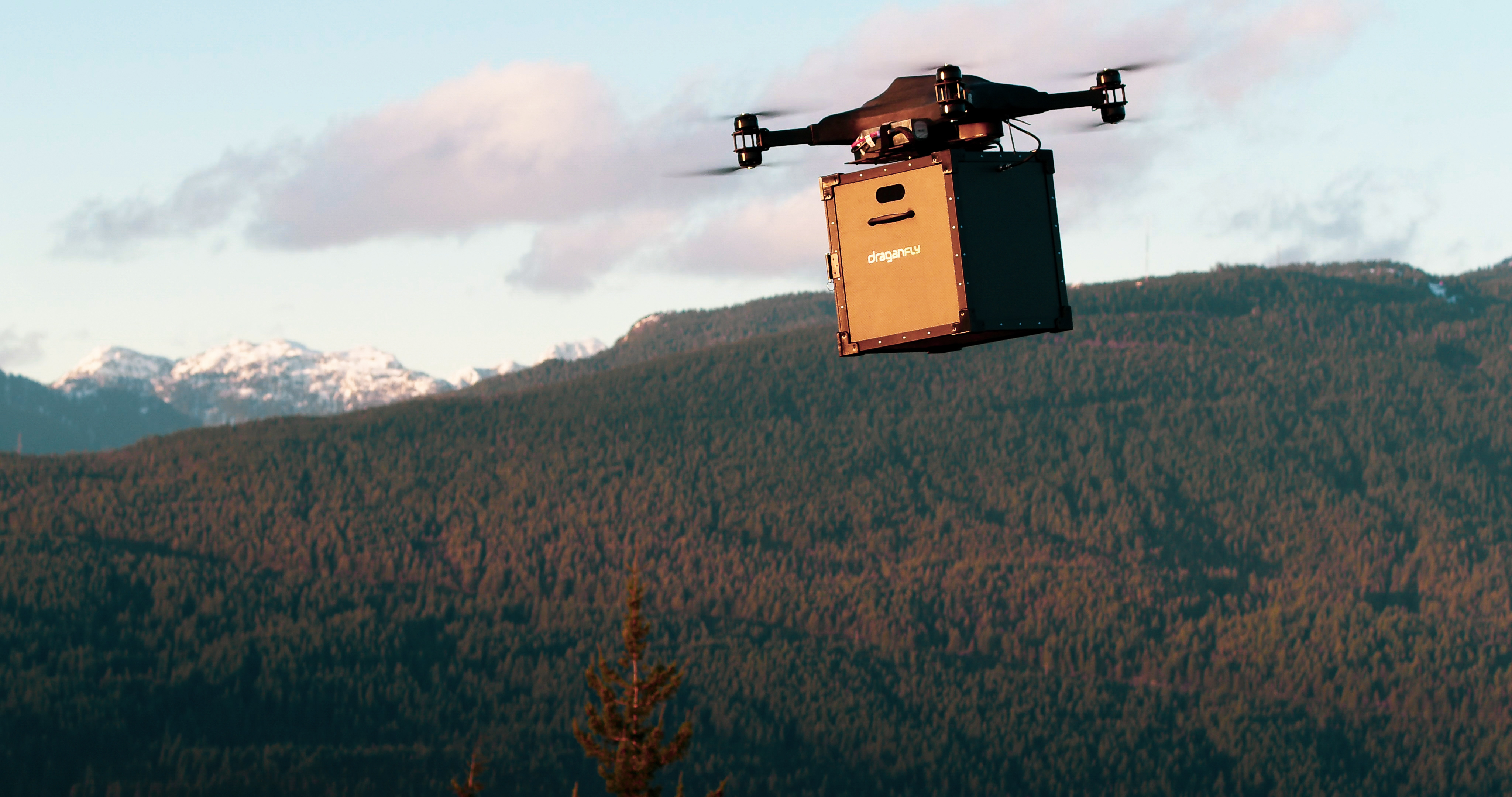 """A robust Covid-19 vaccine drone delivery payload system for use in critical regions is being developed.   The payload to be developed by U.S. company Draganfly, and is a sustainable thermal management system with capability to carry a minimum of 300 multi-doses or 100 single doses. It is being designed as part of a comprehensive delivery and logistics platform of which Draganfly will operate.   """"It is very exciting that COVID-19 vaccinations are starting to be distributed. Draganfly will help us solve the problem which is the timely and precise distribution of the vaccine in hard-to-reach areas."""" said Wayne Williams, Founder and Executive Director of Coldchain Technology.   Draganfly Inc., has been selected by Coldchain Technology Services, LLC to immediately develop and provide flight services.   Coldchain Technology provides comprehensive solutions for healthcare supply chain management for multiple government and commercial clients, including the US Army, the Centers for Disease Control and Prevention, Reserve Component forces, Johnson & Johnson brands, Chicago Department of Public Health, and others and has been leading the deployment of COVID-19 vaccines throughout the United States.   """"Since the beginning of the COVID-19 pandemic, Draganfly has been committed to providing solutions to help prevent the spread of the virus, including our Vital Intelligence systems that can measure vital signs from a camera including your smartphone."""" said Cameron Chell, CEO of Draganfly. """"We are eager to develop this payload and service as we can leverage our extensive patent portfolio as well as secure auto-pilot and flight management system to help with the distribution of the vaccine for Covid-19 and beyond.""""  When: 04 Feb 2021 Credit: Draganfly/Cover-Images.com  **Editorial Use Only**"""