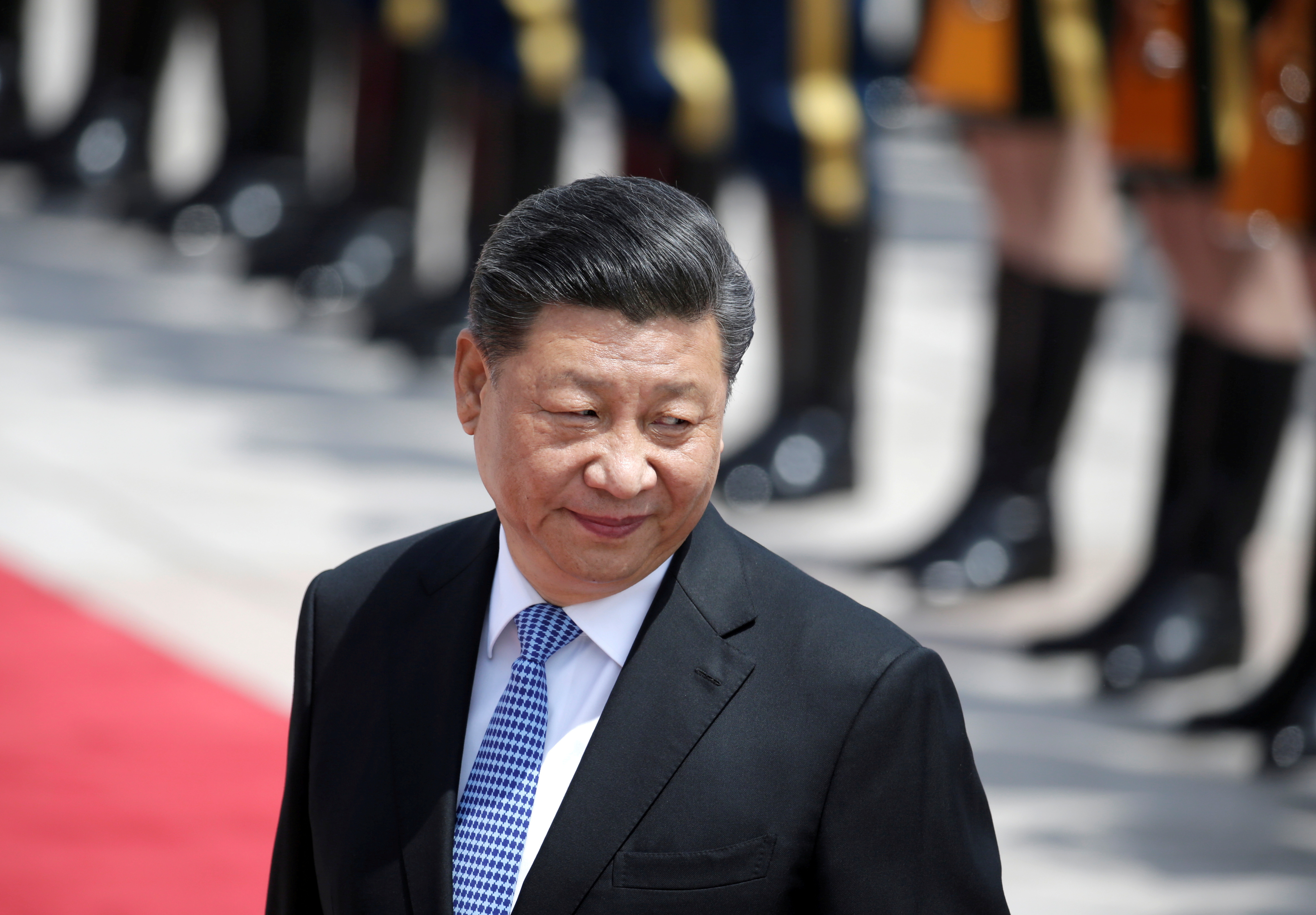 FILE PHOTO: Chinese President Xi Jinping attends a welcoming ceremony for Greek President Prokopis Pavlopoulos outside the Great Hall of the People, in Beijing, China May 14, 2019. REUTERS/Jason Lee/File Photo