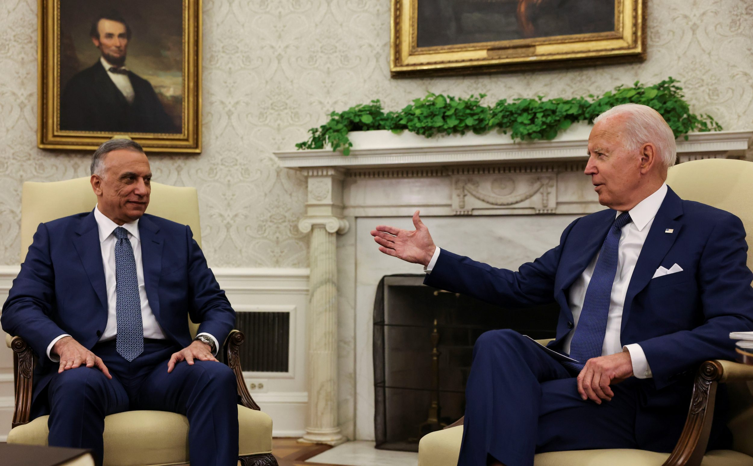 U.S. President Joe Biden SPEAKS with Iraq's Prime Minister Mustafa Al-Kadhimi during a bilateral meeting in the Oval Office at the White House in Washington, U.S., July 26, 2021. REUTERS/Evelyn Hockstein
