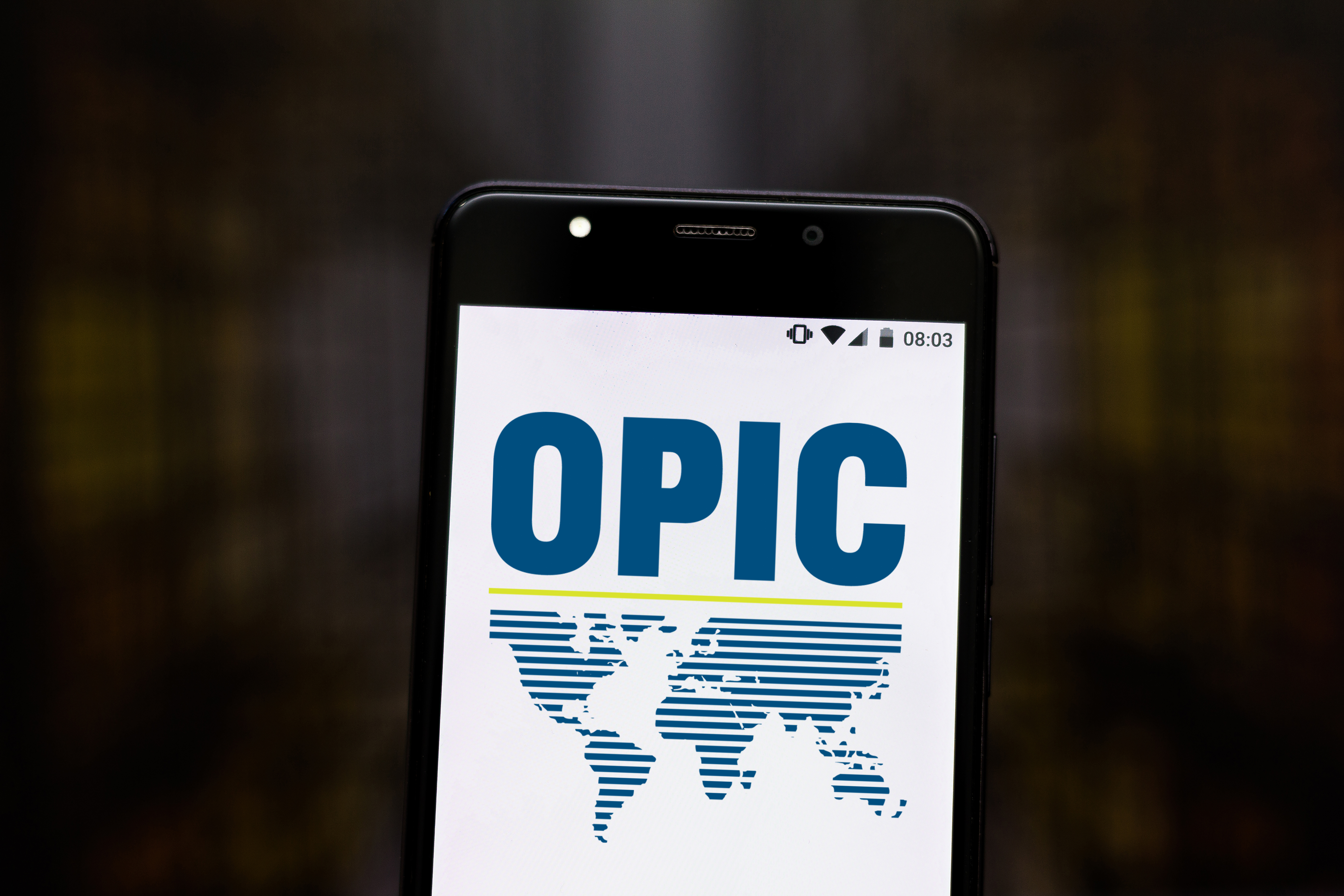 August 6, 2019, Brazil. In this photo illustration the Overseas Private Investment Corporation (OPIC) logo is displayed on a smartphone.