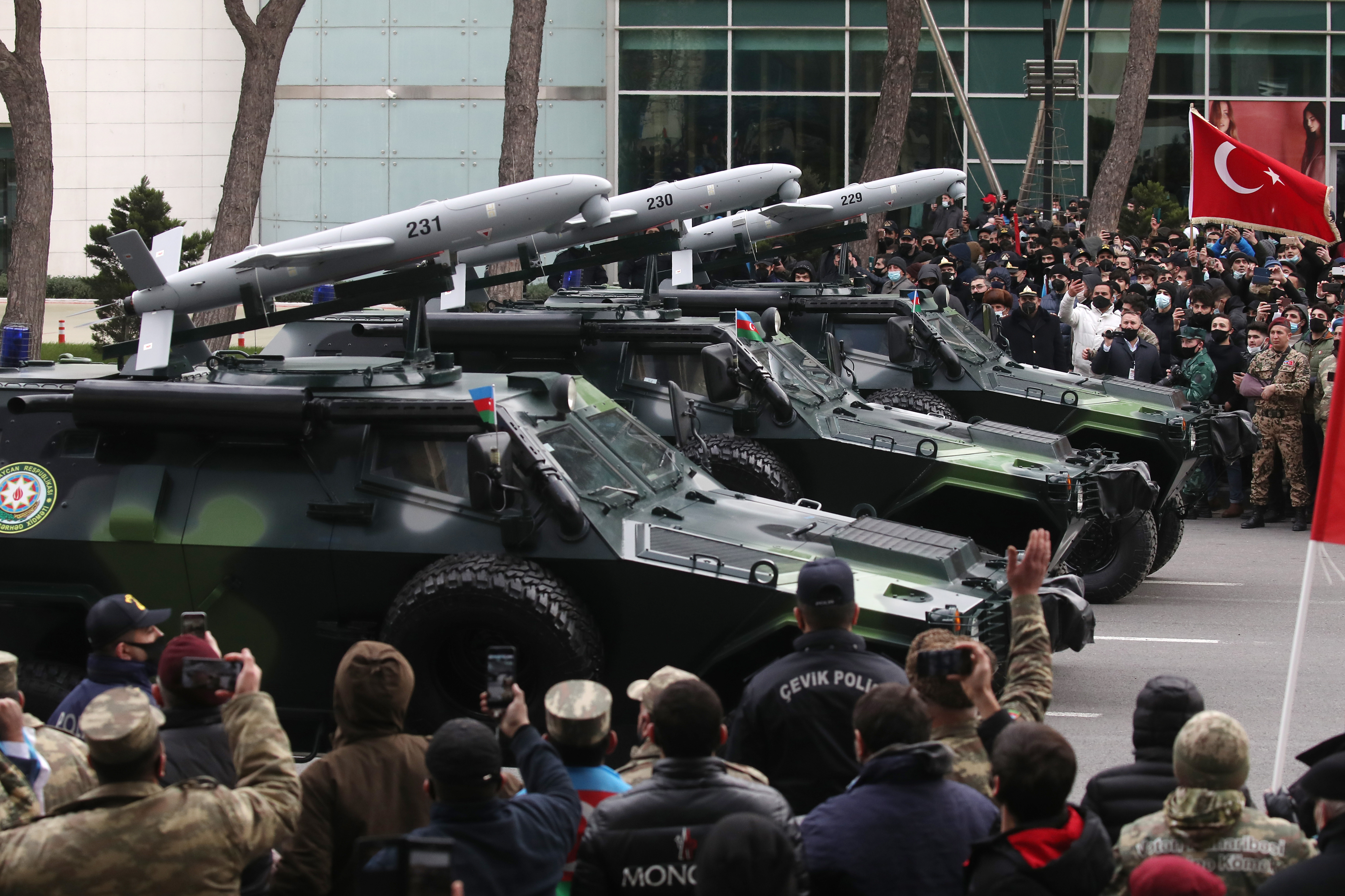 BAKU, AZERBAIJAN - DECEMBER 10, 2020: Cobra armored vehicles equipped with PK machine guns and Sky Striker loitering munitions take part in a military parade marking the end of the Nagorno Karabakh military conflict. Valery Sharifulin/TASS.No use Russia.