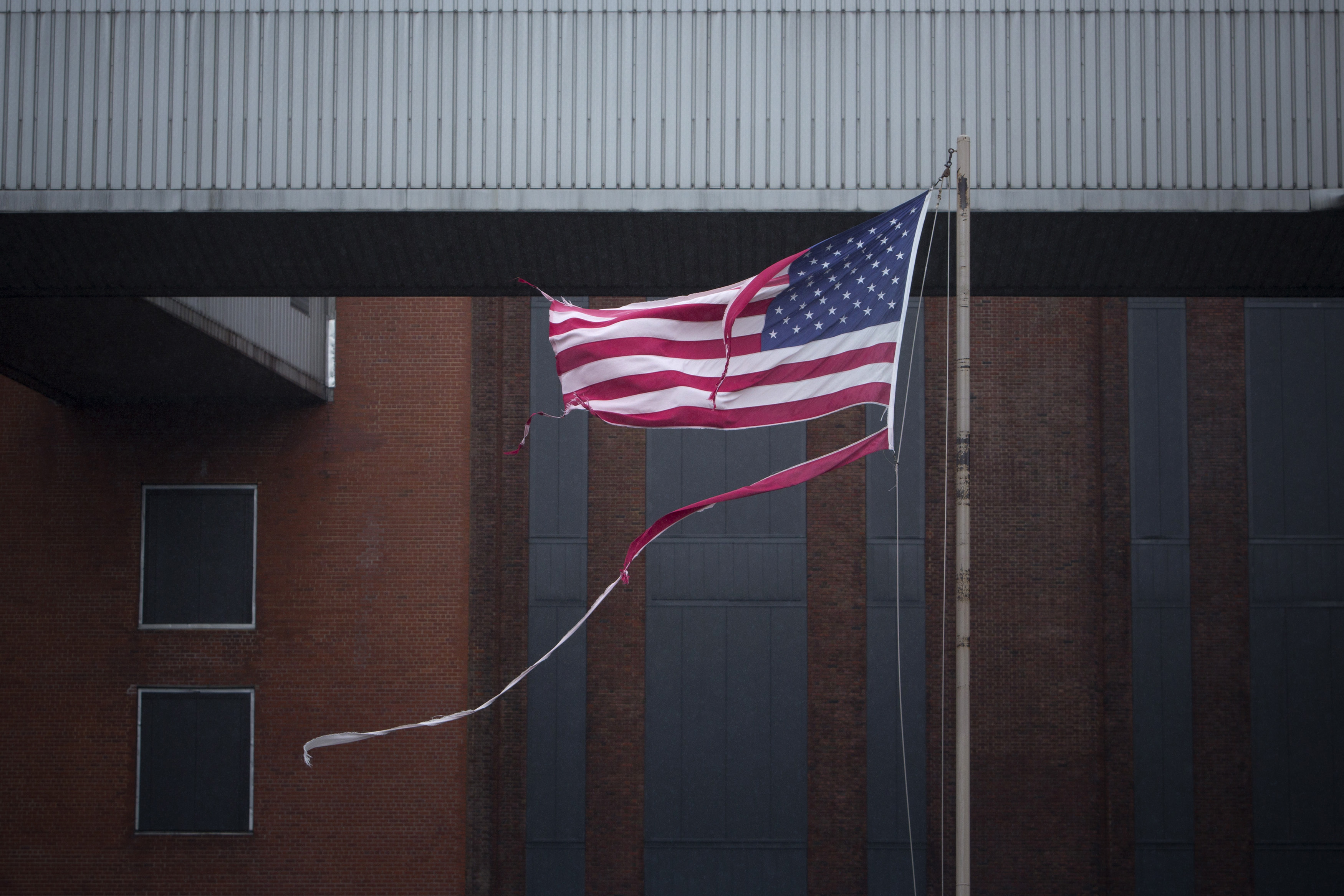 A tattered U.S. flag flies at the Con Edison Substation in Downtown Manhattan