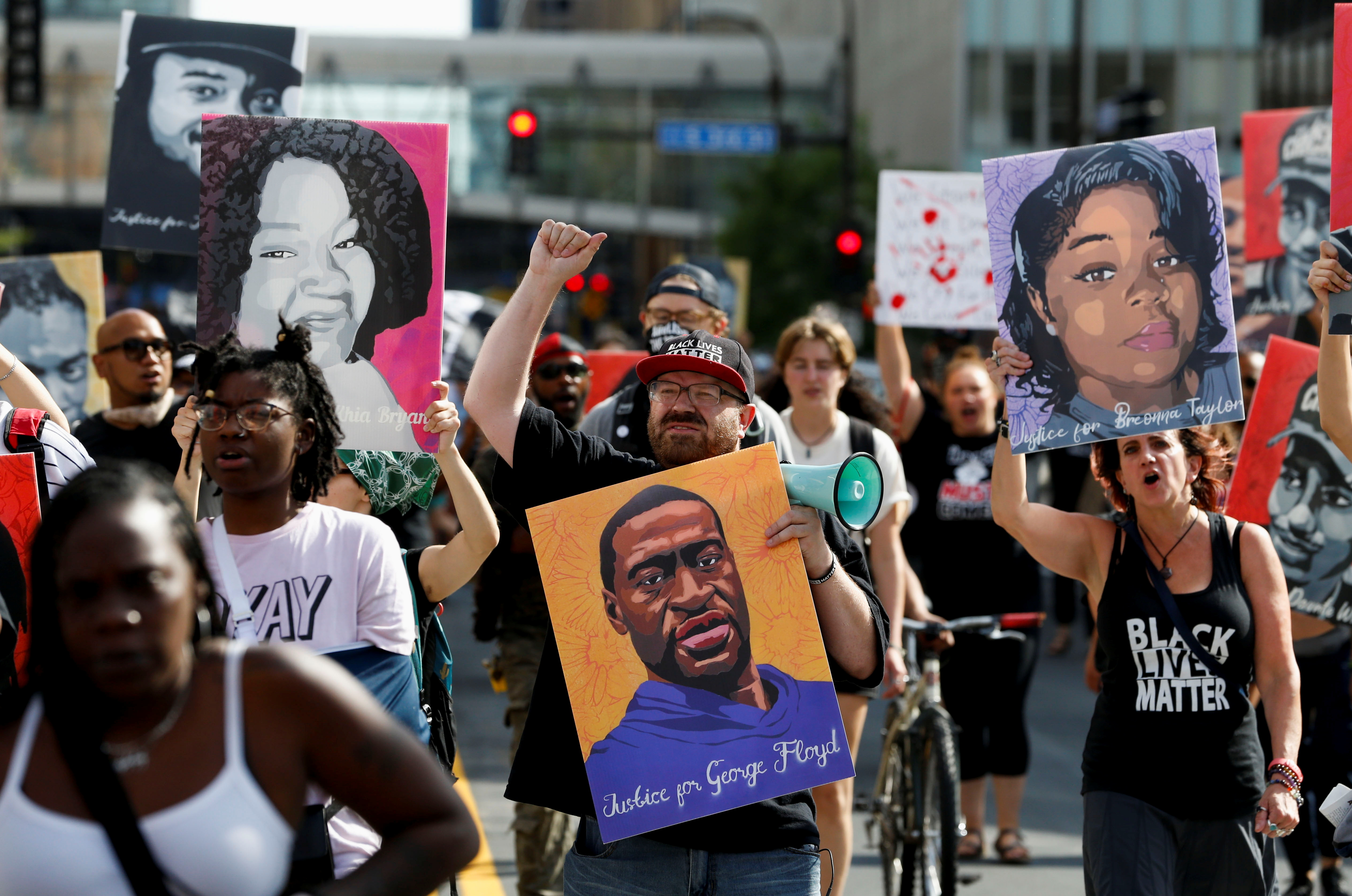 Protesters march during a brief rally after the sentencing of Derek Chauvin, the former Minneapolis policeman found guilty of killing George Floyd, a Black man, in Minneapolis, Minnesota, U.S. June 25, 2021. REUTERS/Eric Miller