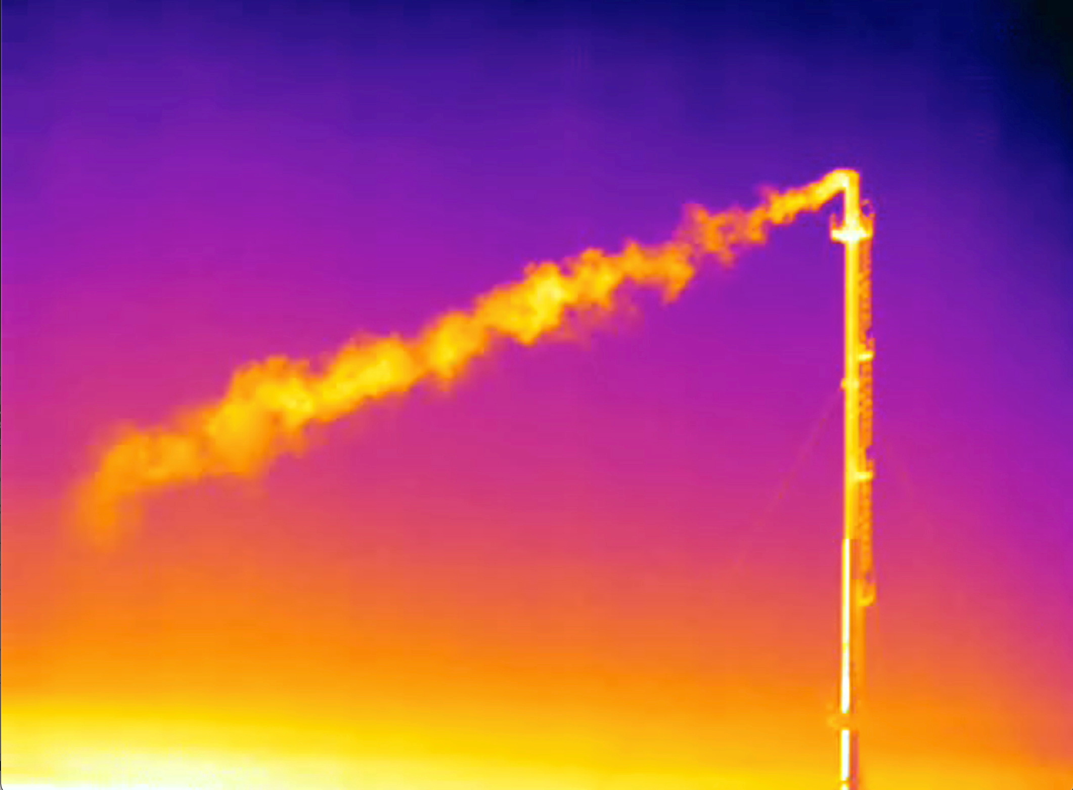 Thermographic video footage shows what appears to be a plume of methane gas flowing from a vent stack at a storage facility in Minerbio