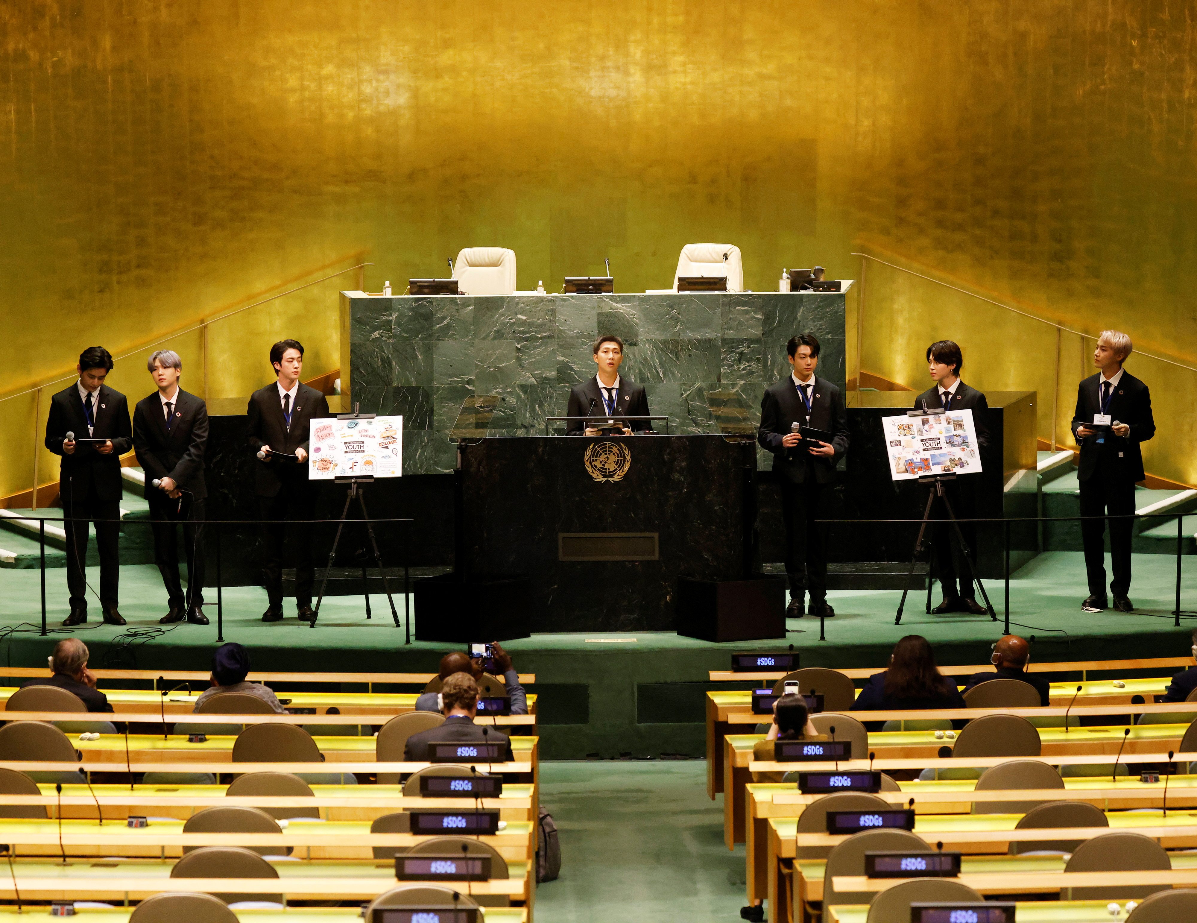 (L to R) Taehyung/V, Suga, Jin, RM, Jungkook, Jimin and J-Hope of South Korean boy band BTS speak at the SDG Moment event as part of the UN General Assembly 76th session General Debate in UN General Assembly Hall at the United Nations Headquarters, in New York, U.S., September 20, 2021. John Angelillo/Pool via REUTERS