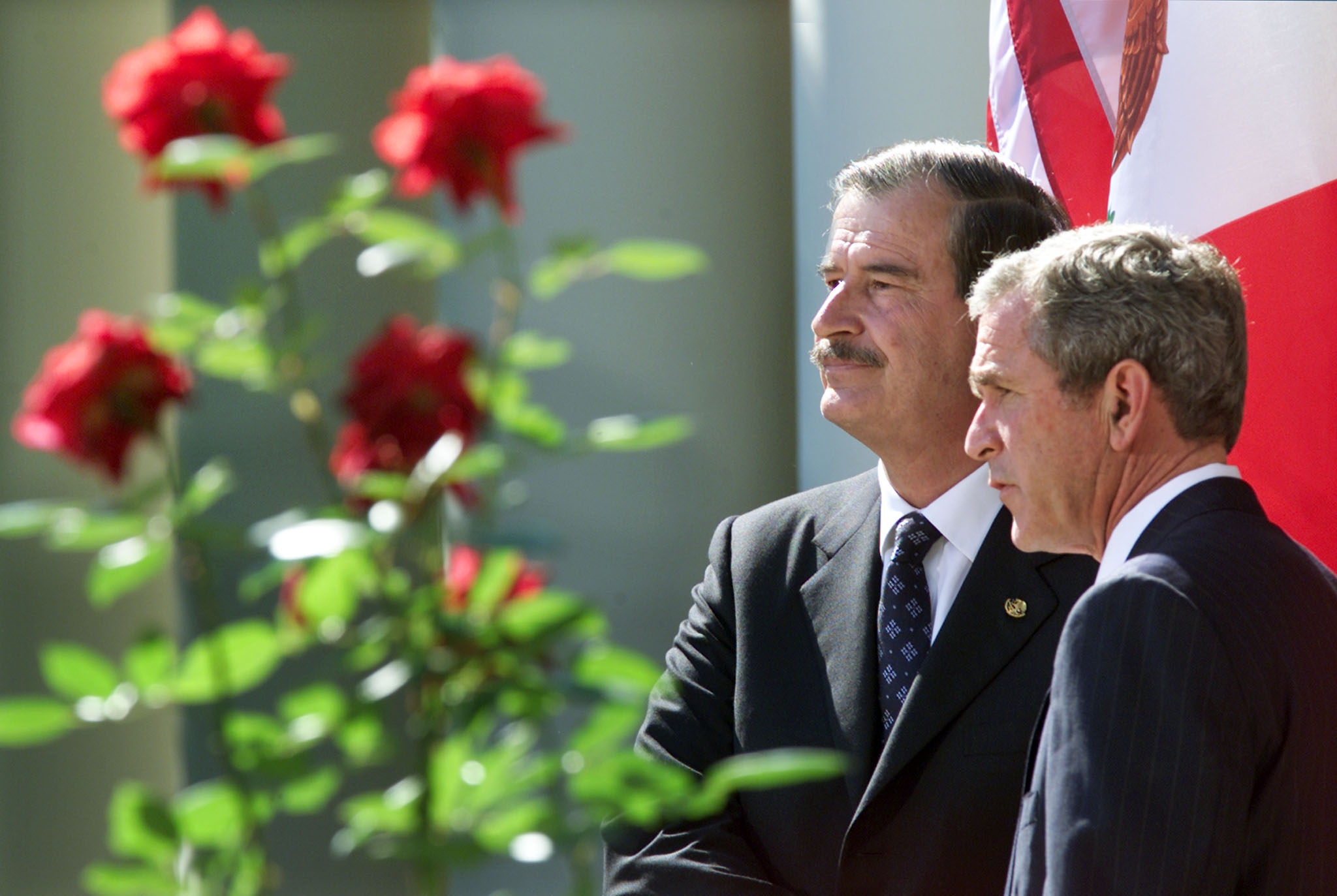 U.S. President George W. Bush (R) stands with Mexican President VicenteFox as they address the media in the Rose Garden at the White House,October 4, 2001. Fox came to the White House to show support for theUnited States response to the attacks in New York and Washington.REUTERS/Gary HershornGMH/ME