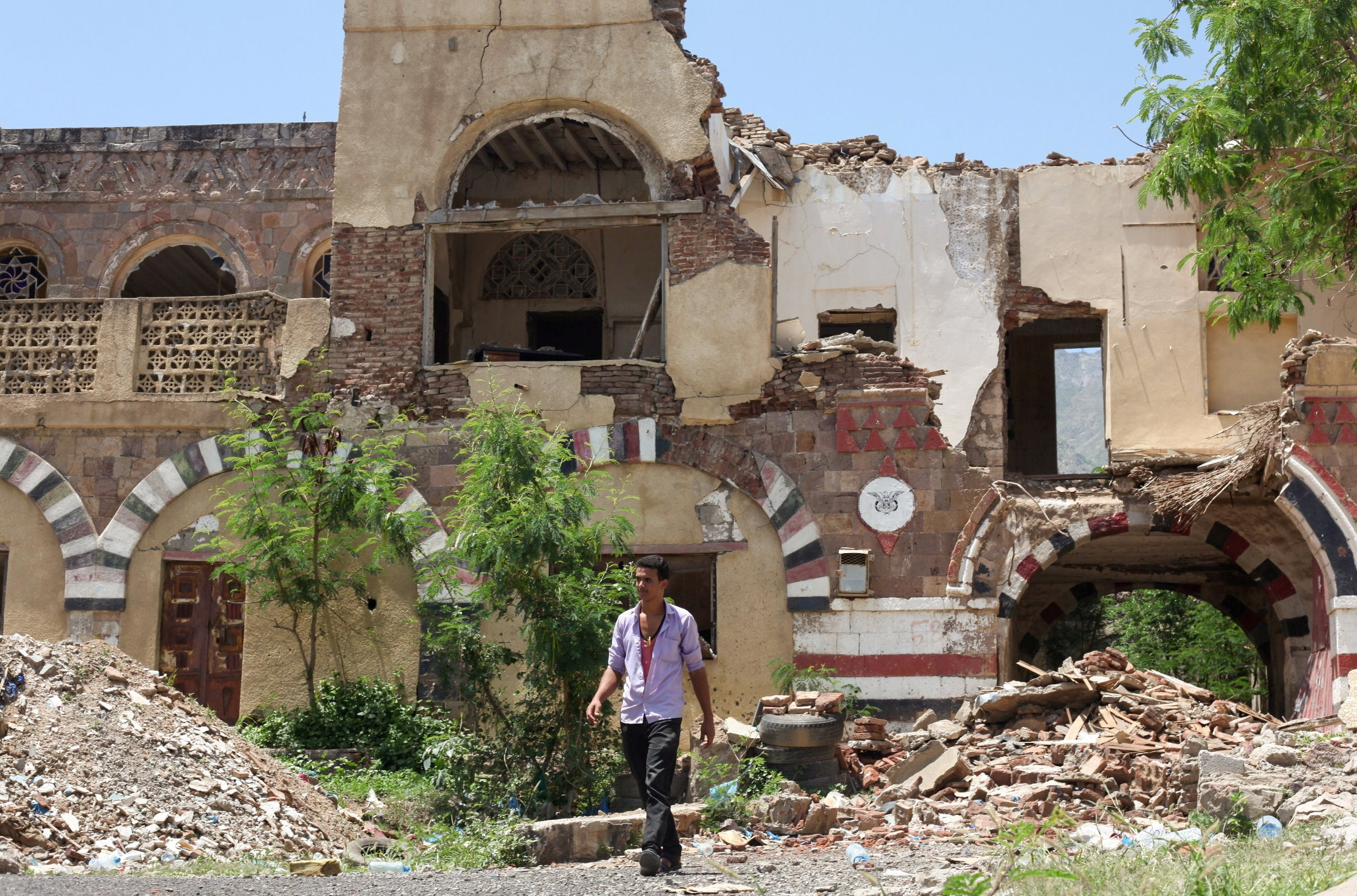 A worker walks past the National Museum in the southwestern city of Taiz, Yemen May 26, 2021. Picture taken May 26, 2021. REUTERS/Anees Mahyoub