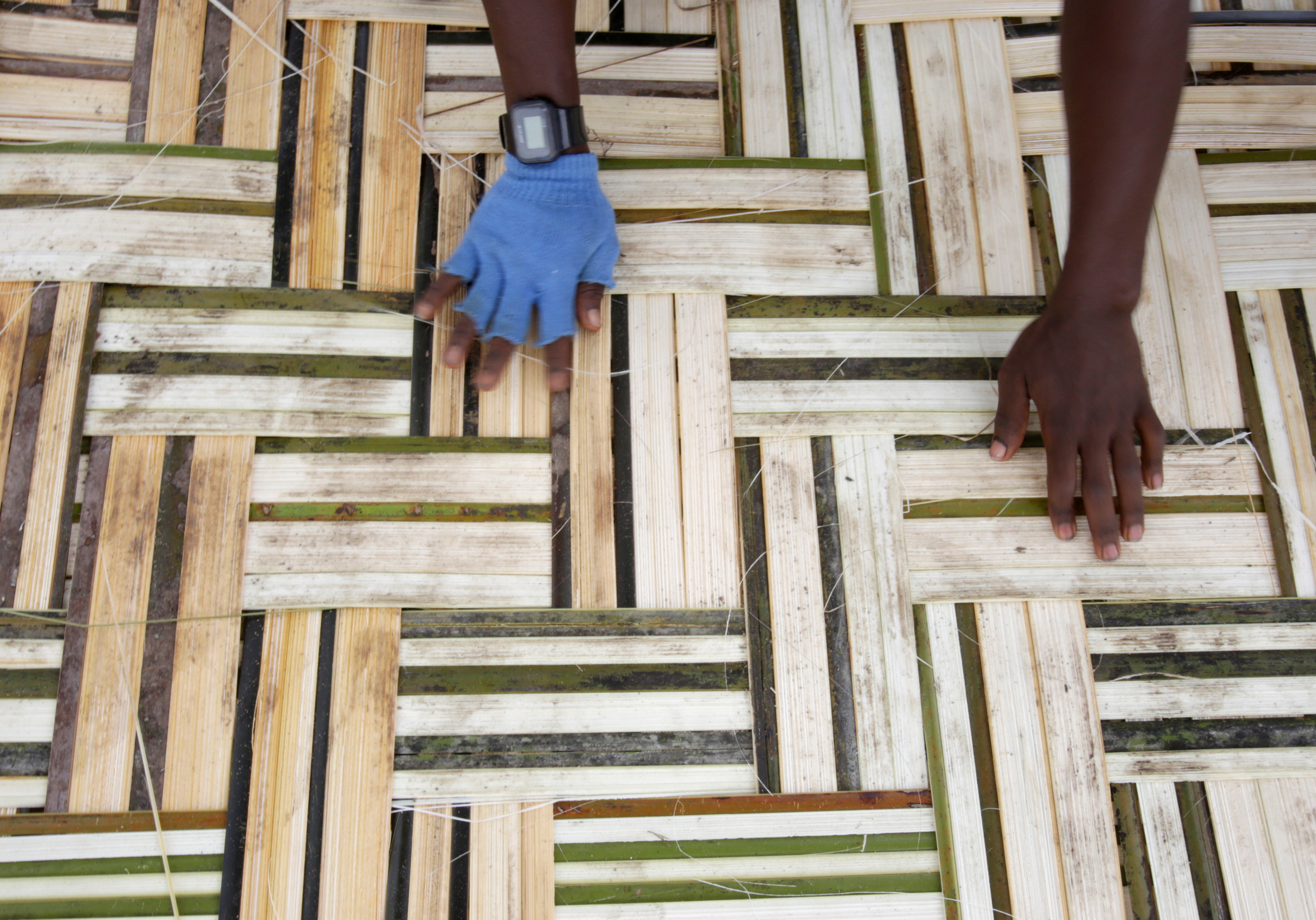 A man works on bamboo mat in Monrovia, Liberia, October 14, 2017. REUTERS/Thierry Gouegnon