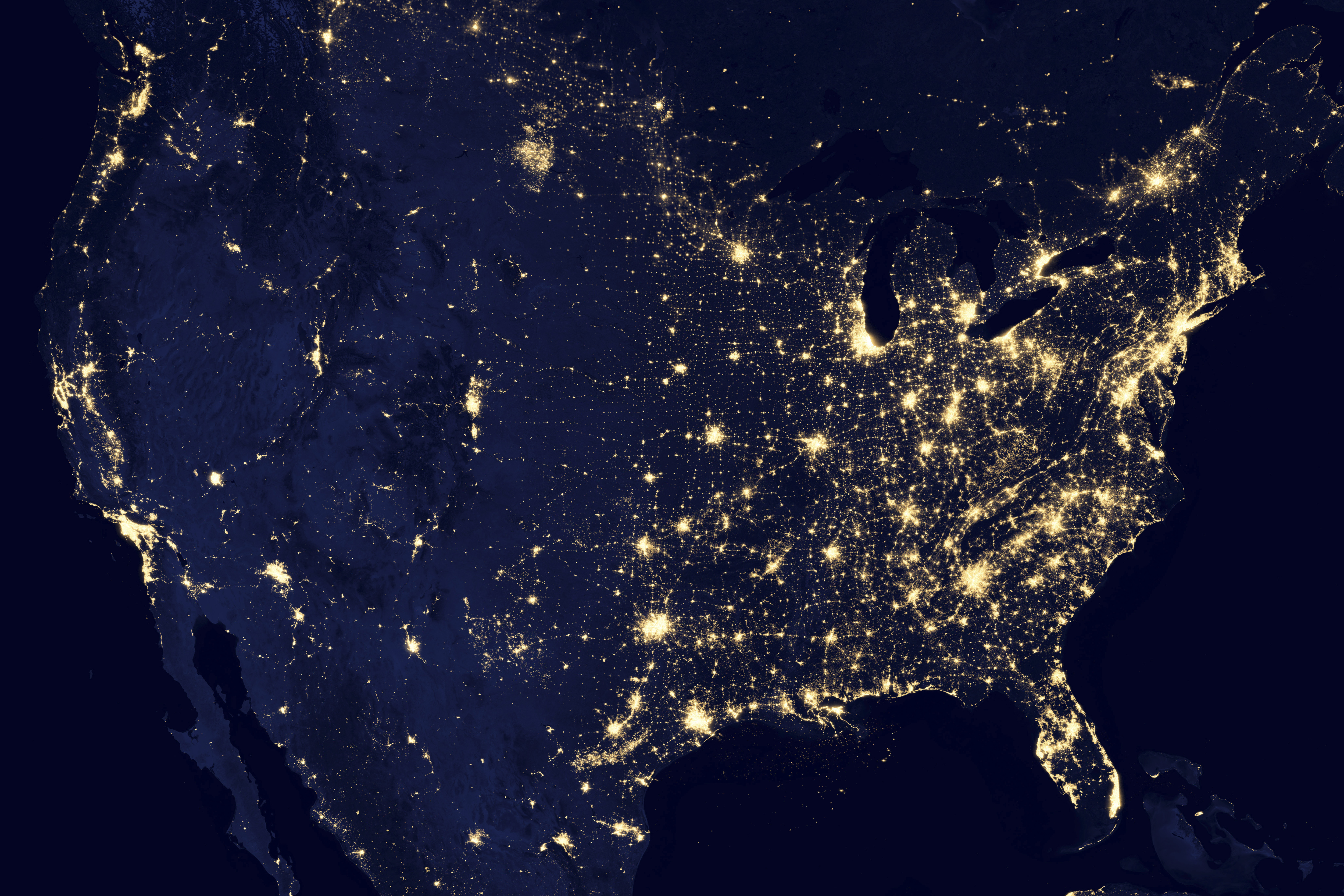 """NASA satellite image shows the United States, Mexico and Canada at night in this composite assembled from data acquired by the Suomi NPP satellite in April and October 2012. The image was made possible by the new satellite's """"day-night band"""" of the Visible Infrared Imaging Radiometer Suite (VIIRS), which detects light in a range of wavelengths from green to near-infrared and uses filtering techniques to observe dim signals such as city lights, gas flares, auroras, wildfires, and reflected moonlight. REUTERS/NASA/Robert Simmon/NOAA/Department of Defense/Handout (UNITED STATES - Tags: ENVIRONMENT SCIENCE TECHNOLOGY TPX IMAGES OF THE DAY) FOR EDITORIAL USE ONLY. NOT FOR SALE FOR MARKETING OR ADVERTISING CAMPAIGNS. THIS IMAGE HAS BEEN SUPPLIED BY A THIRD PARTY. IT IS DISTRIBUTED, EXACTLY AS RECEIVED BY REUTERS, AS A SERVICE TO CLIENTS"""