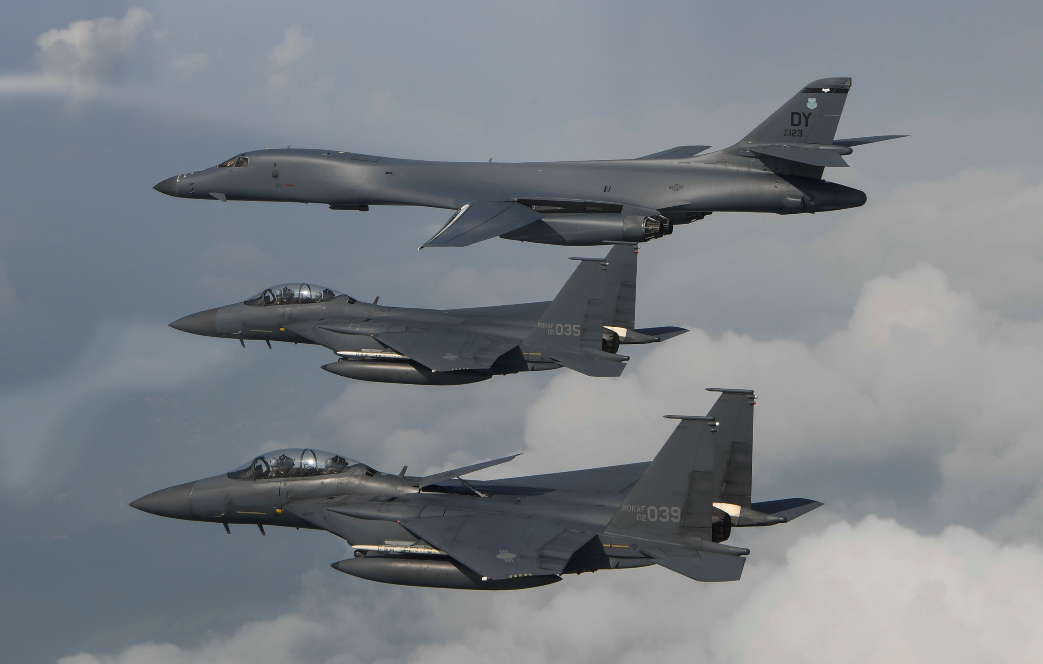 A U.S. Air Force B-1B Lancer assigned to the 9th Expeditionary Bomb Squadron, deployed from Dyess Air Force Base, Texas, is joined by Republic of Korea air force F-15s, during a 10-hour mission from Andersen Air Force Base, Guam, into Japanese airspace and over the Korean Peninsula, July 30, 2017.  Photo taken July 30, 2017.  Tech. Sgt. Kamaile Casillas/Pacific Air Forces/DVIDS/Handout via REUTERS   ATTENTION EDITORS - THIS IMAGE WAS PROVIDED BY A THIRD PARTY