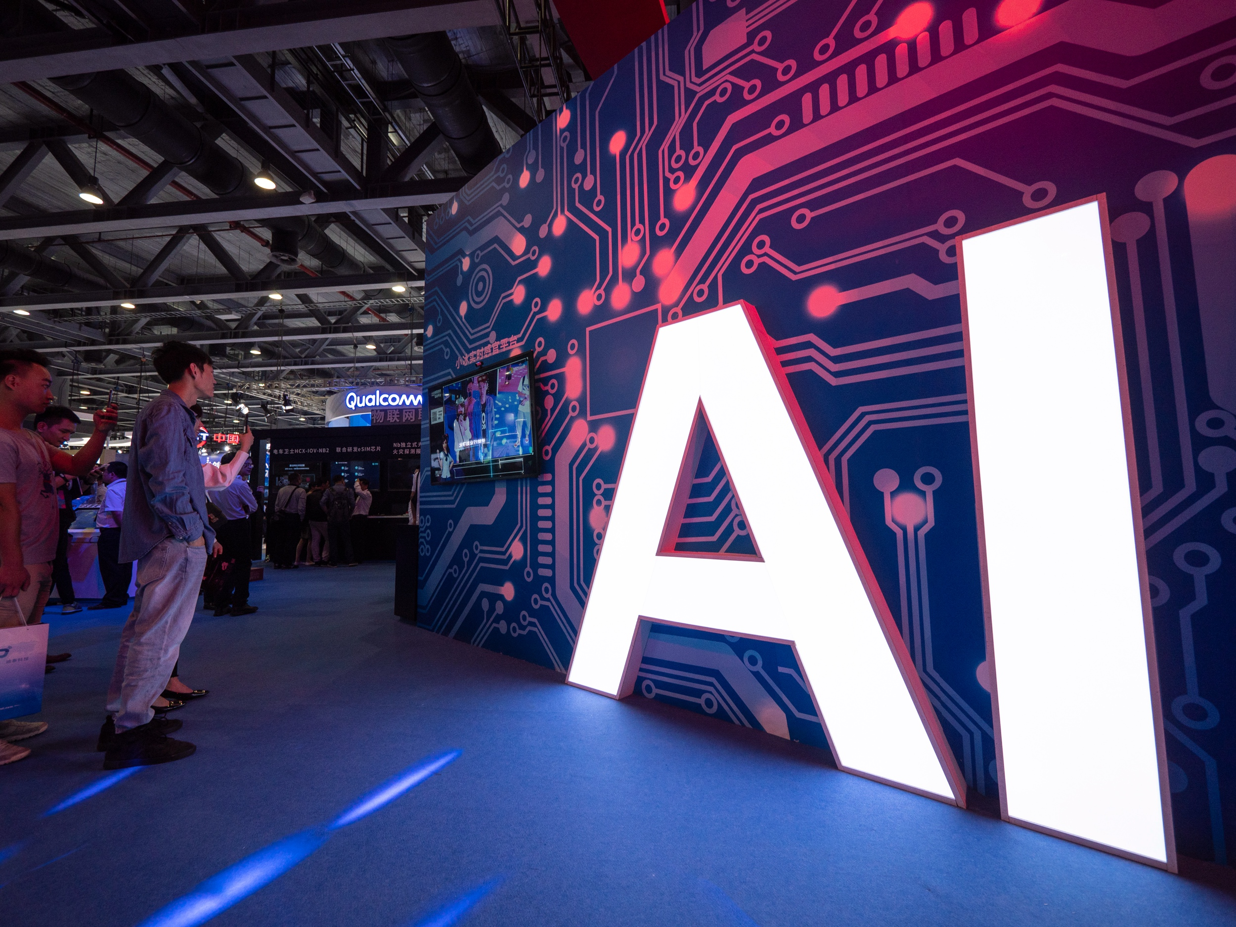 A signage of Artificial Intelligence (AI) is seen at the stand of Xiaomi during the 2018 China Mobile Global Partner Conference in Guangzhou city, south China's Guangdong province.