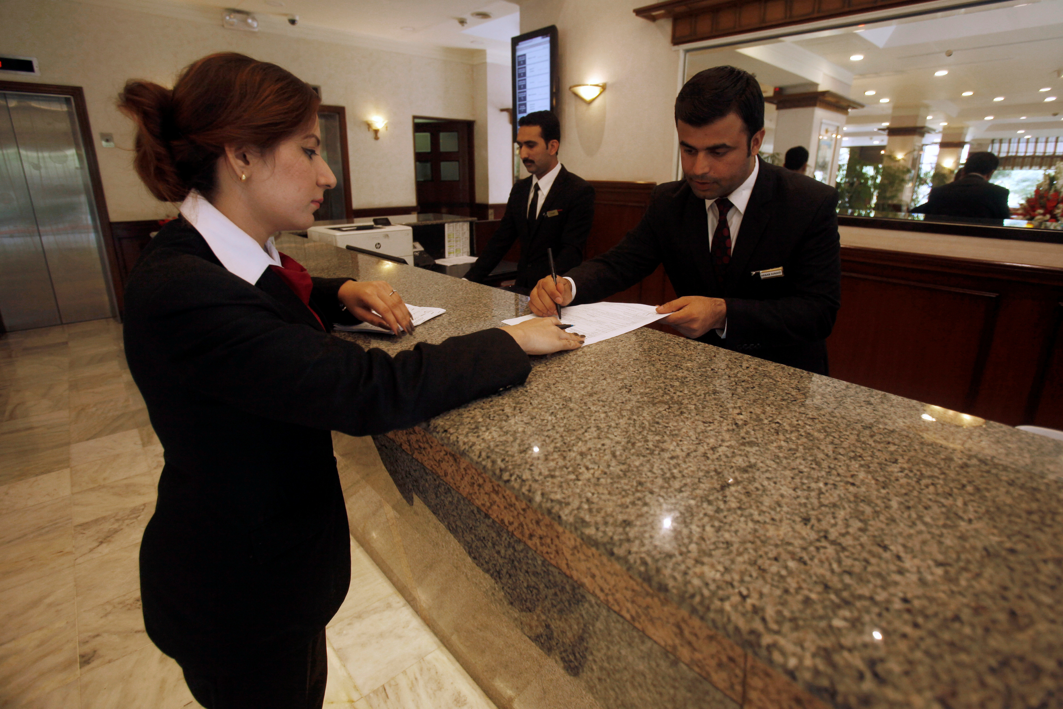 The reception desk staff is seen at the Pearl Continental hotel in Peshawar, Pakistan April 10, 2018. REUTERS/Fayaz Aziz